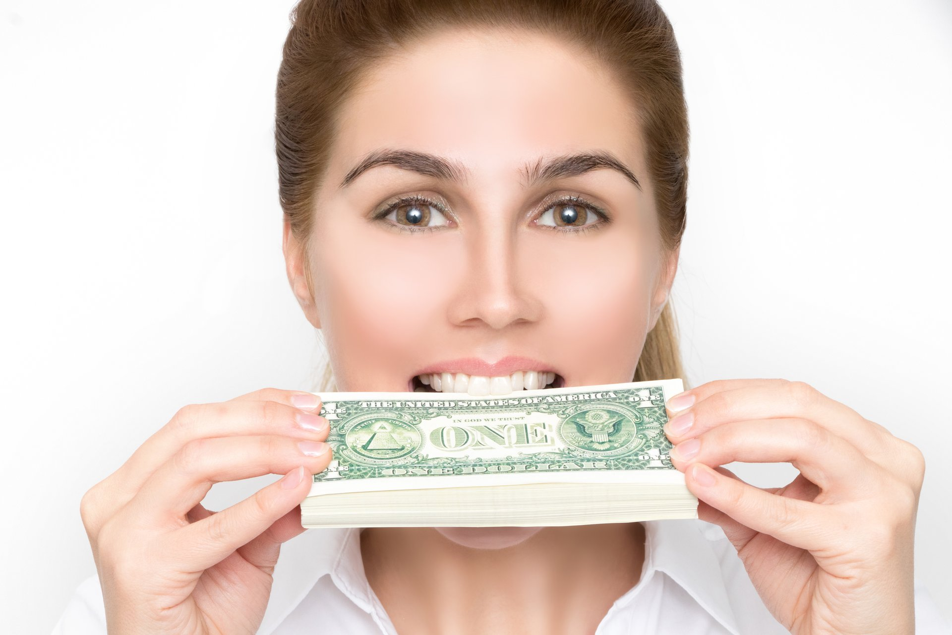 Smiling woman with money