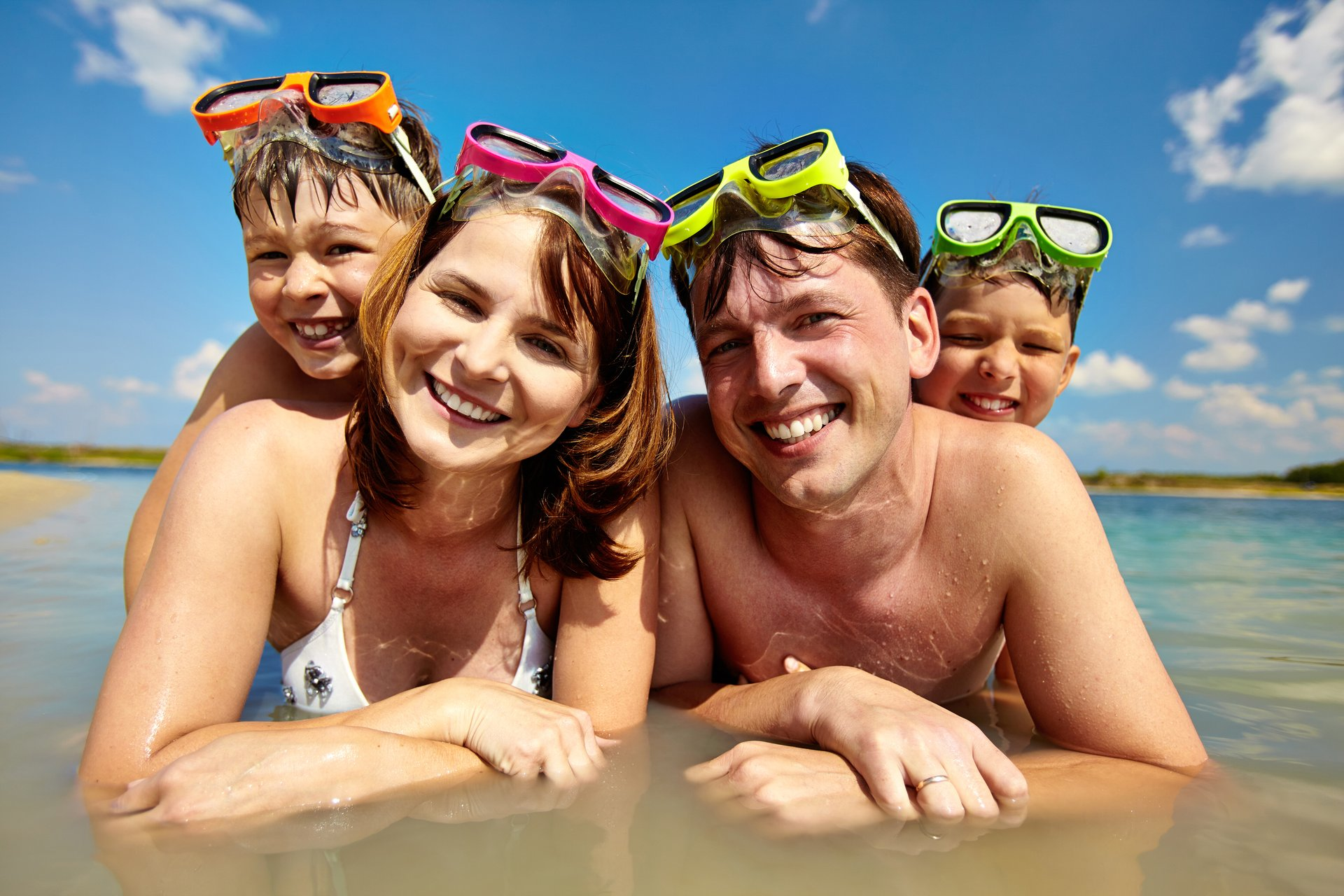 A family enjoys the beach while on summer vacation