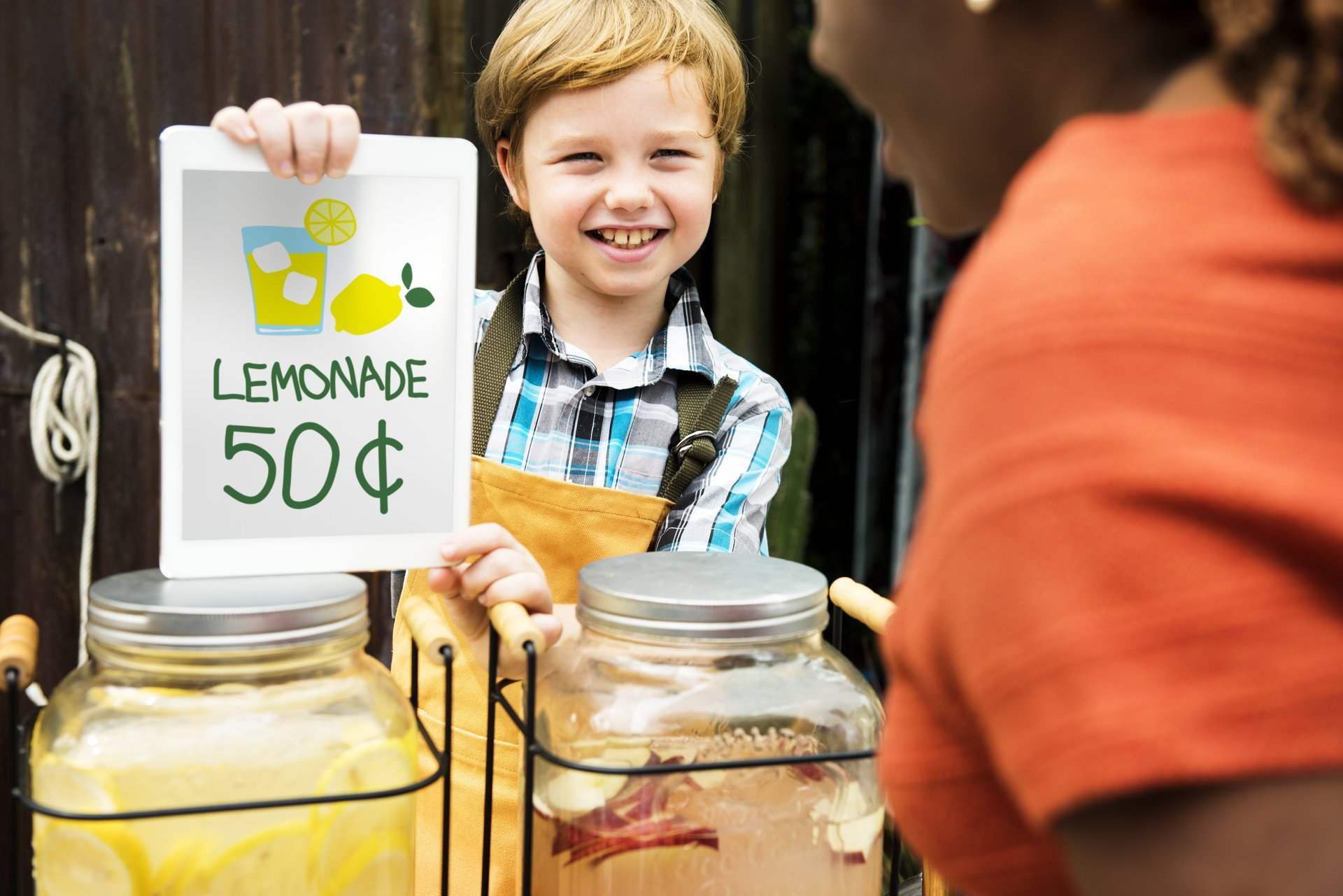 A boy sells lemonade