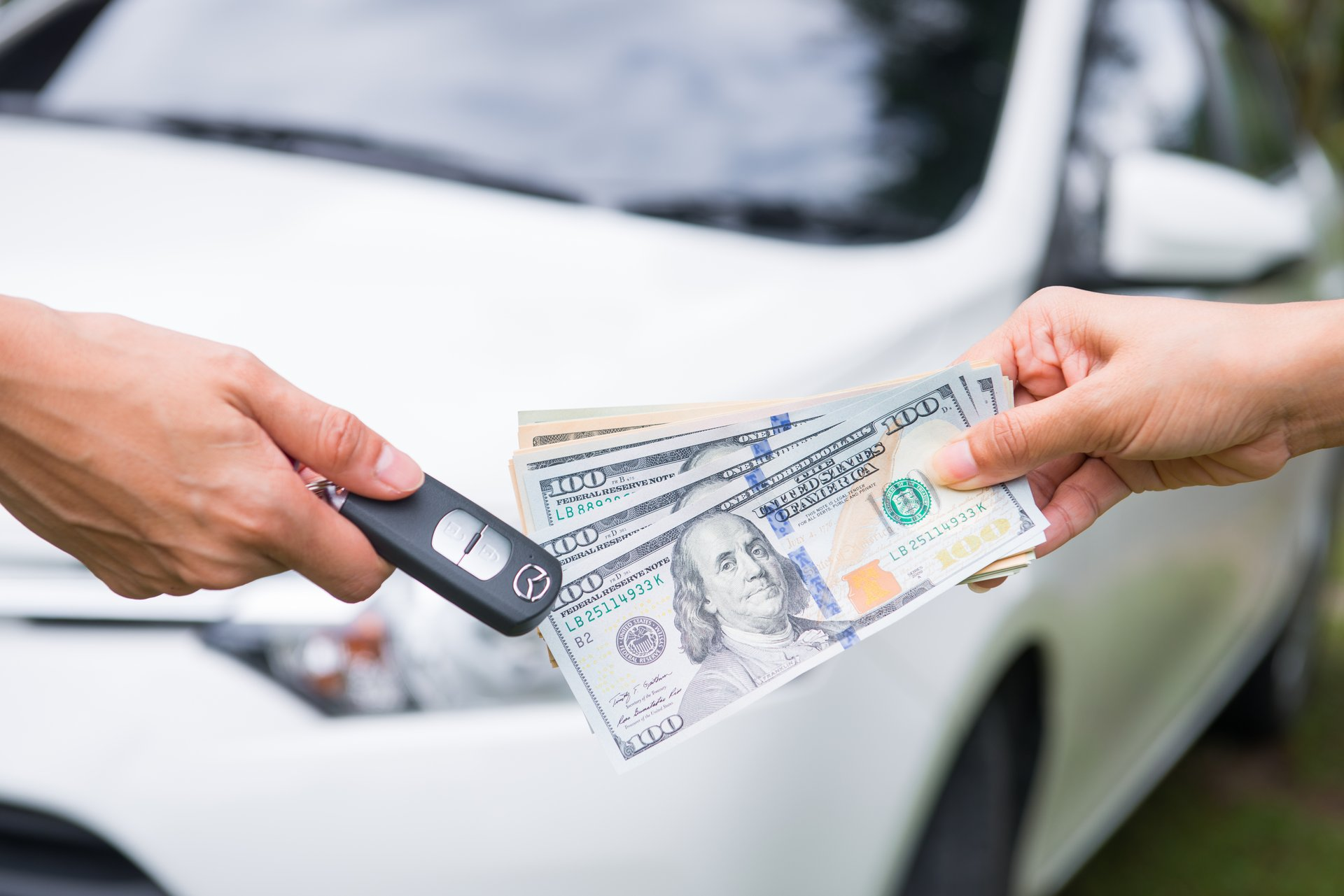 Car owner selling vehicle for cash