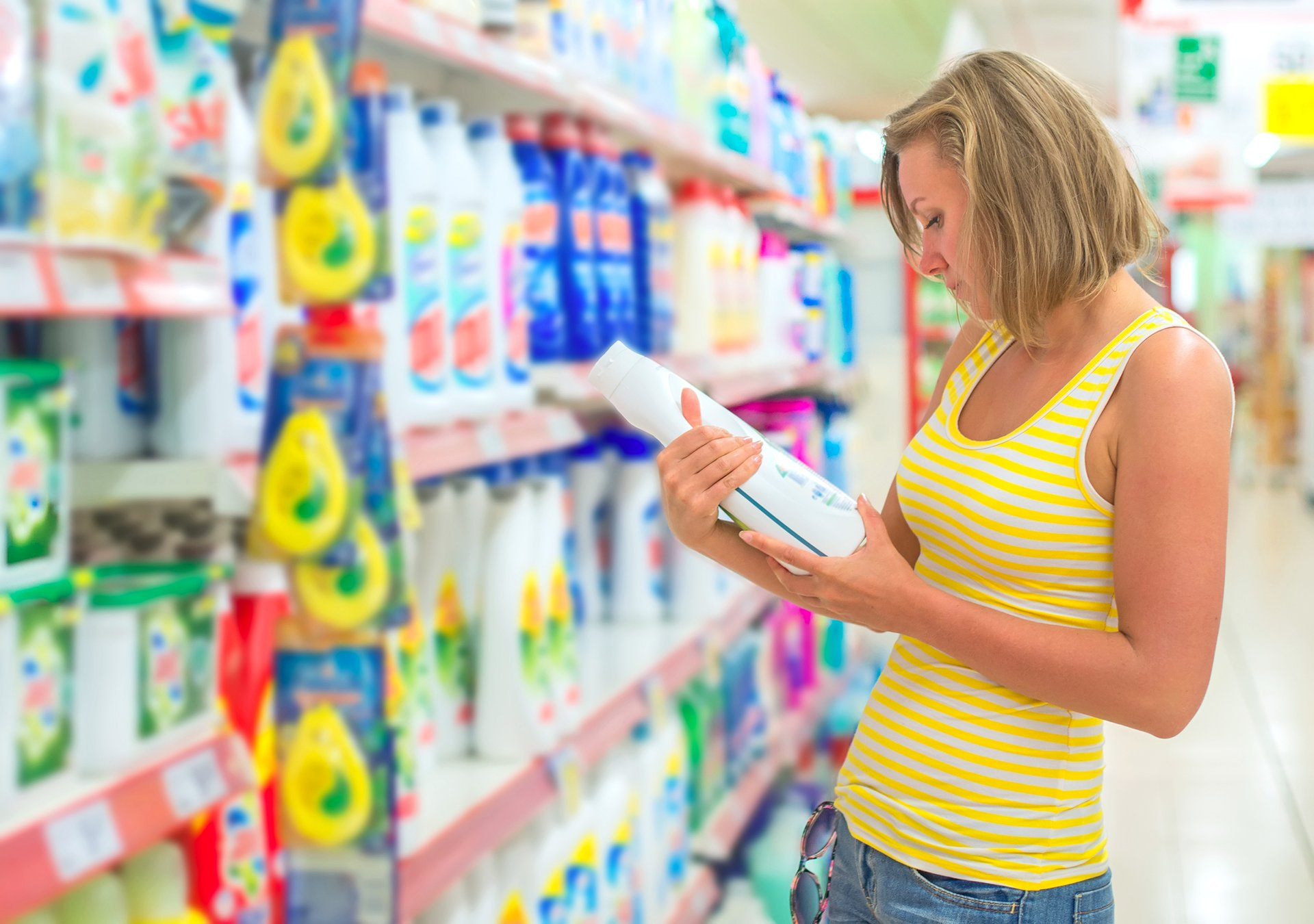 Royalty-free stock photo ID: 228756514 Woman choosing laundry detergent in grocery store