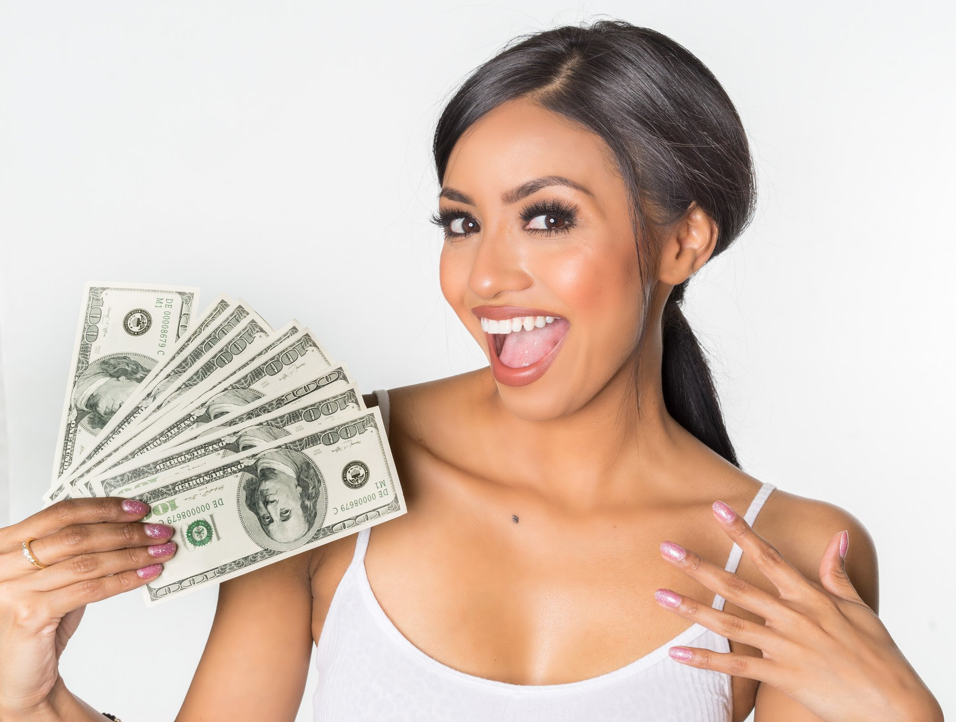 Woman holding wad of money