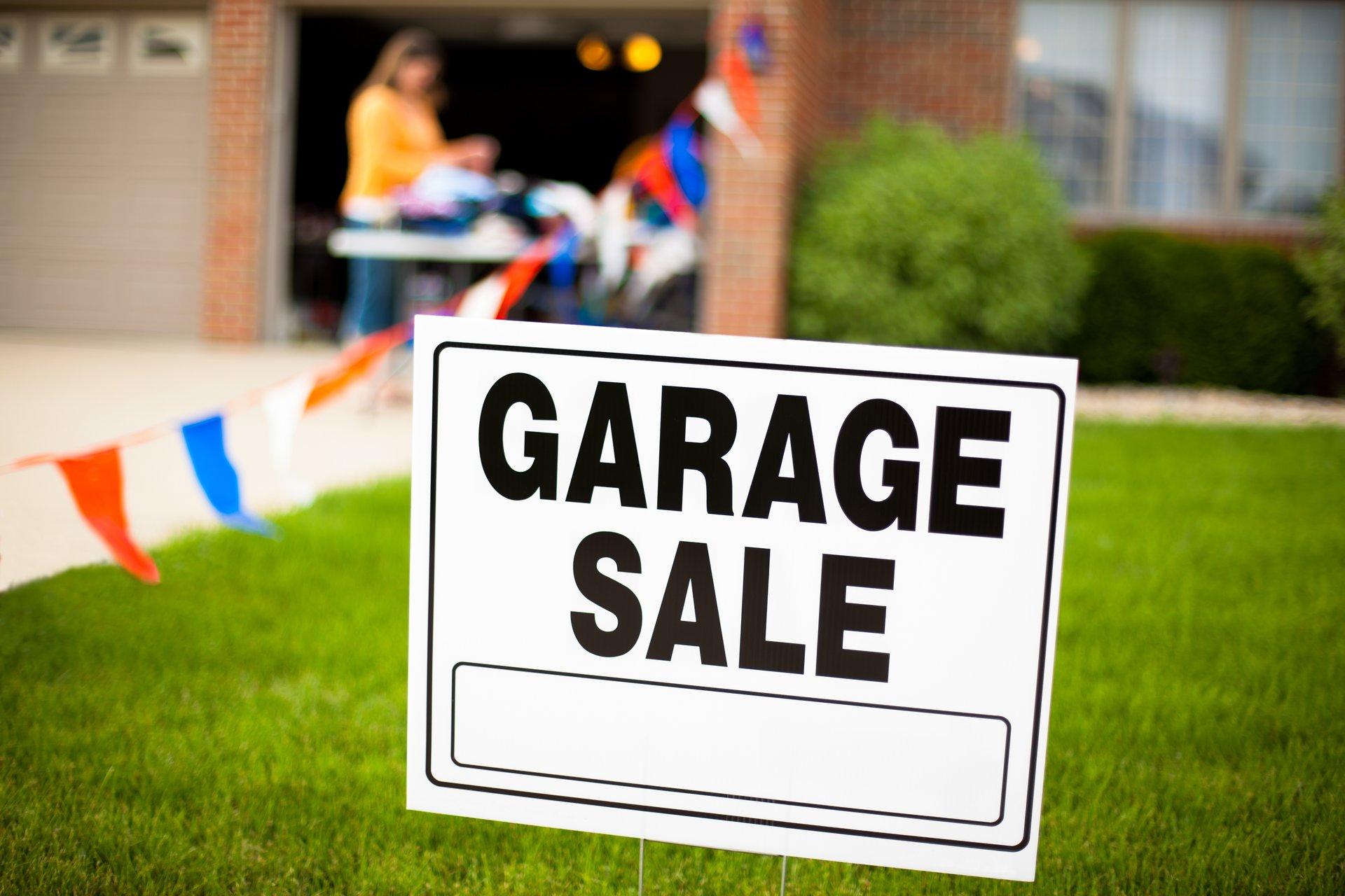 Garage sale sign in yard