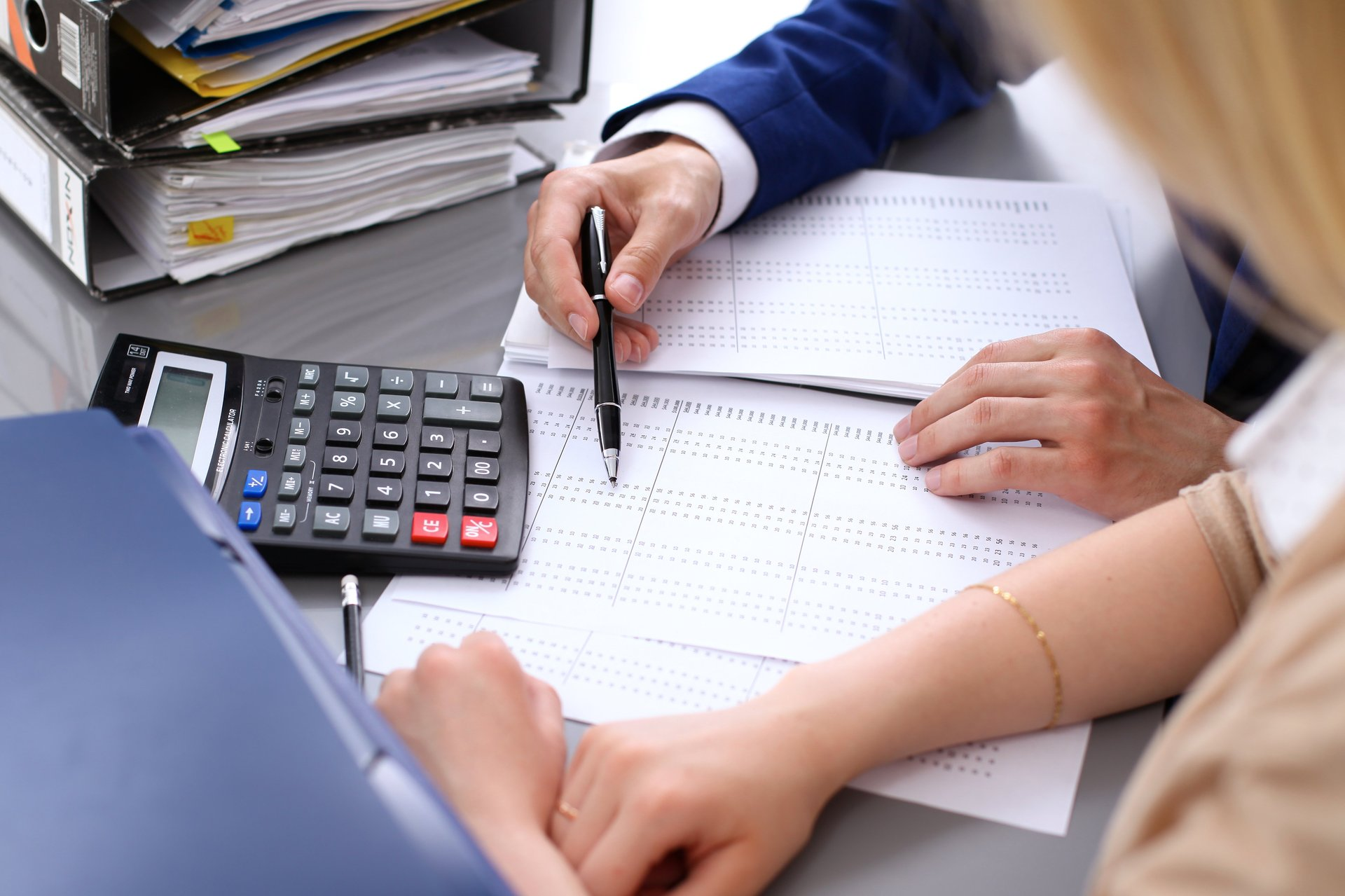 A woman works on her taxes with an accountant