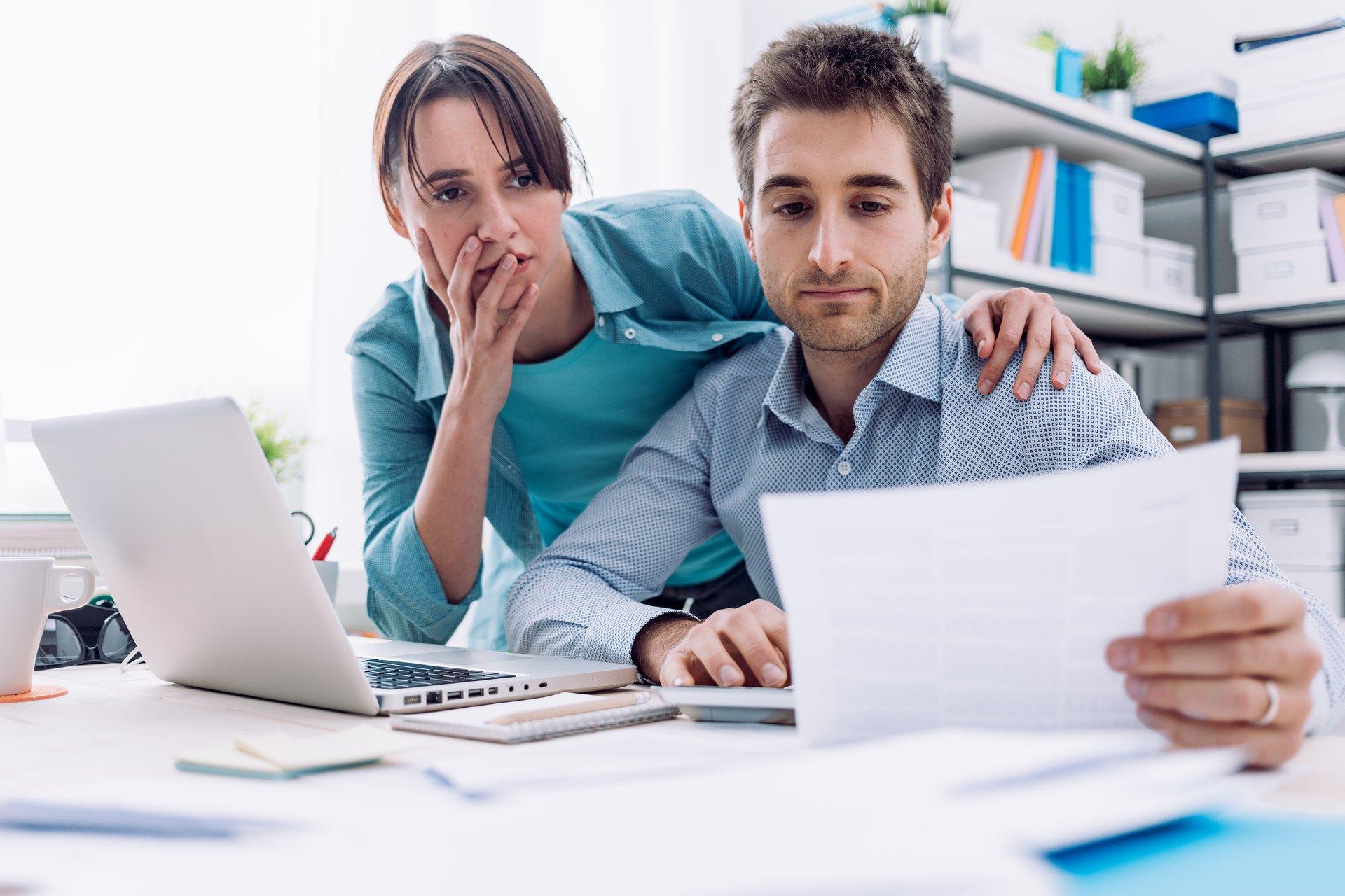Couple looking at bills.