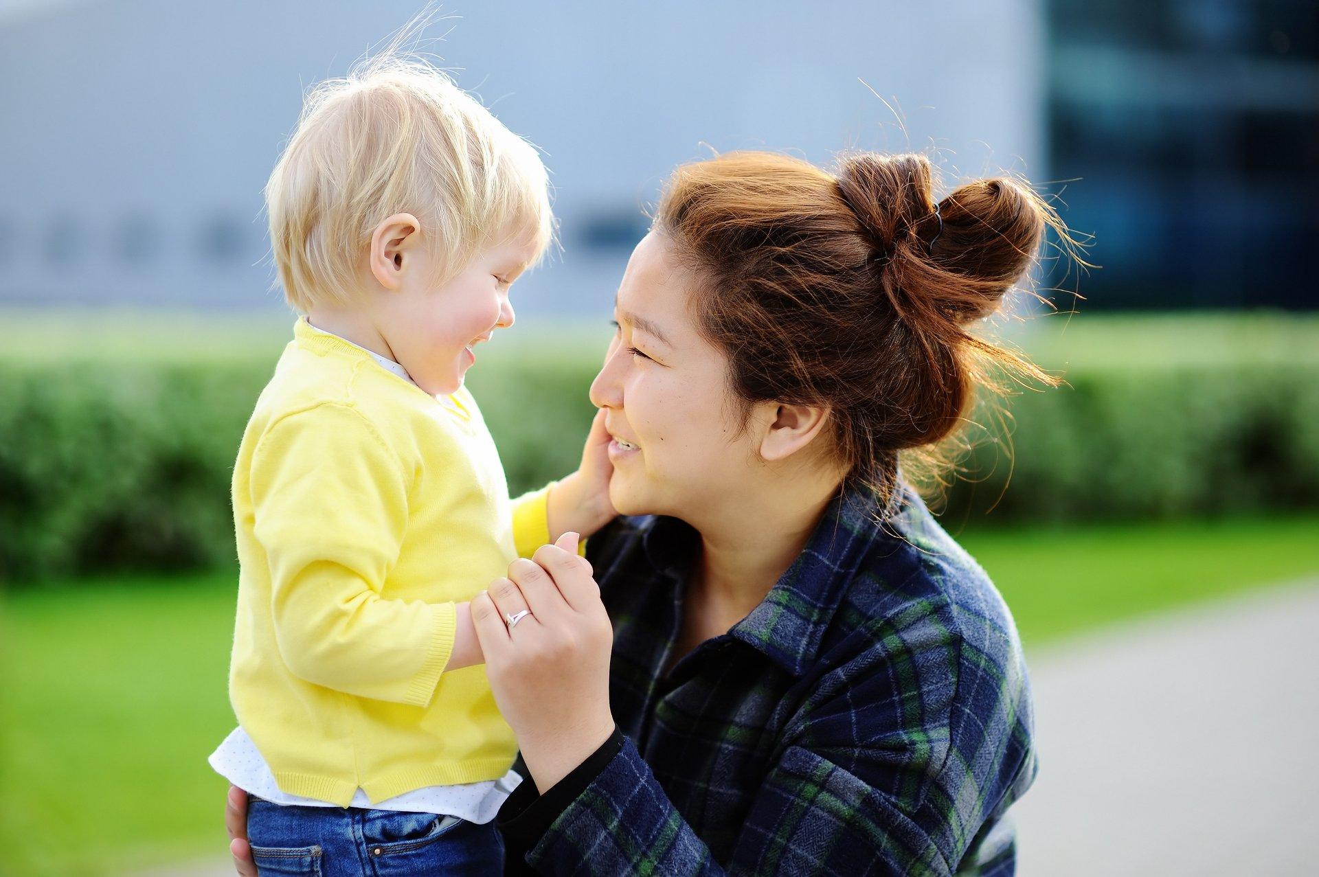 A woman babysits a toddler