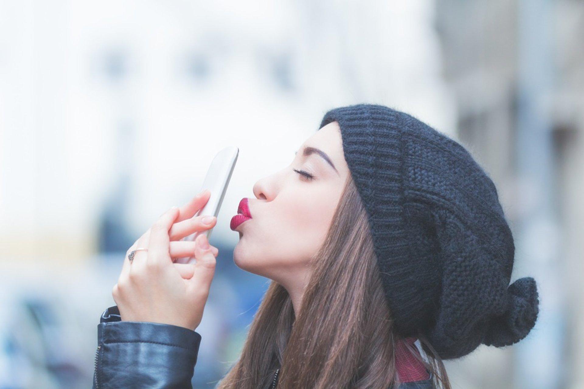 Woman Kissing Phone