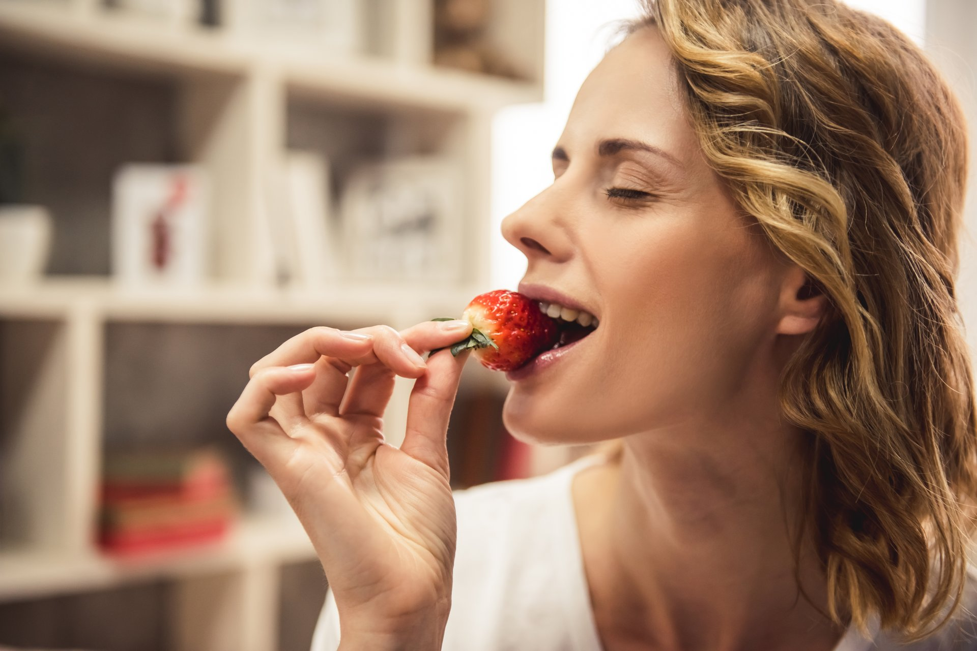 Woman with a strawberry