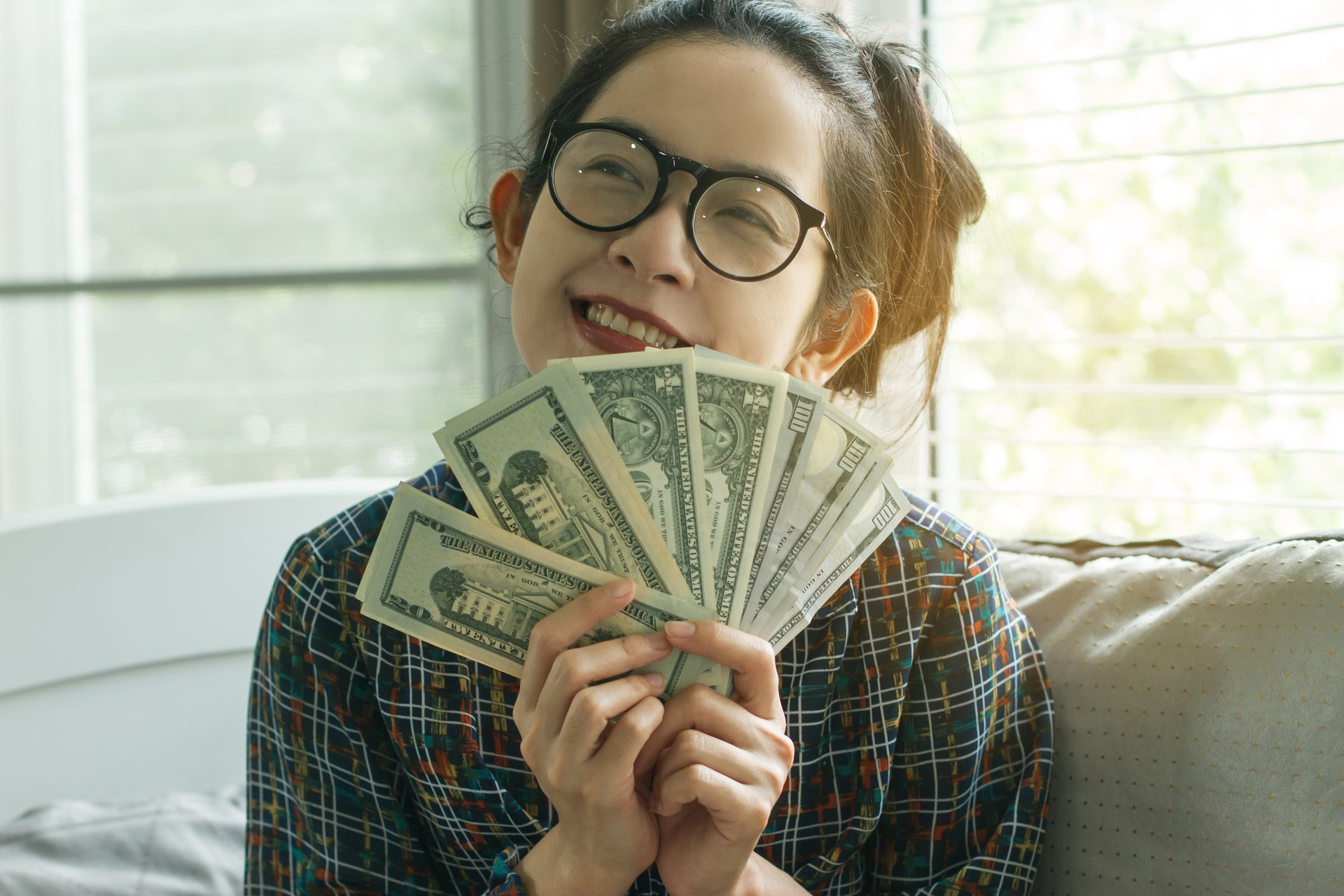 A woman holds cash