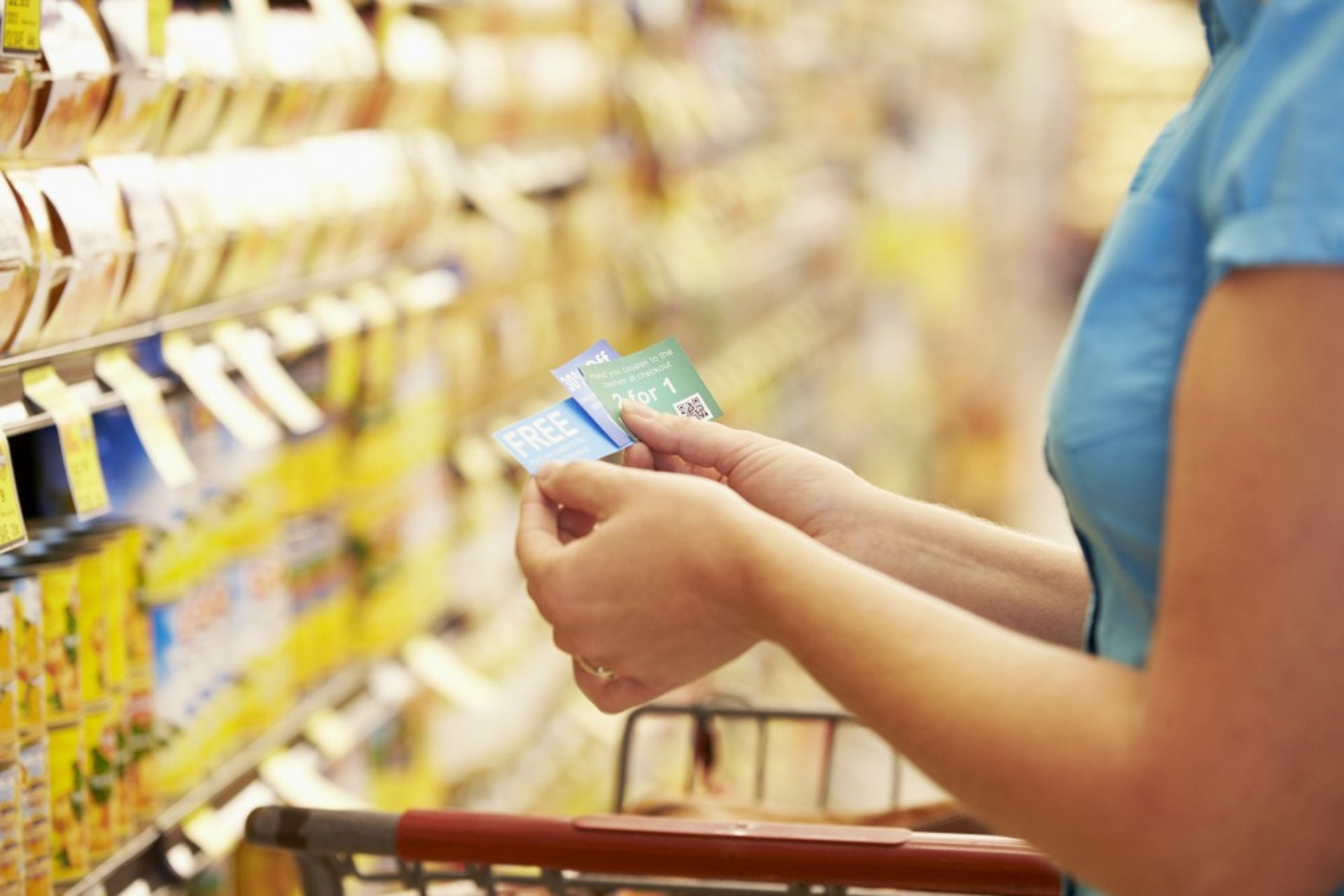 Shopper using coupons at a grocery store