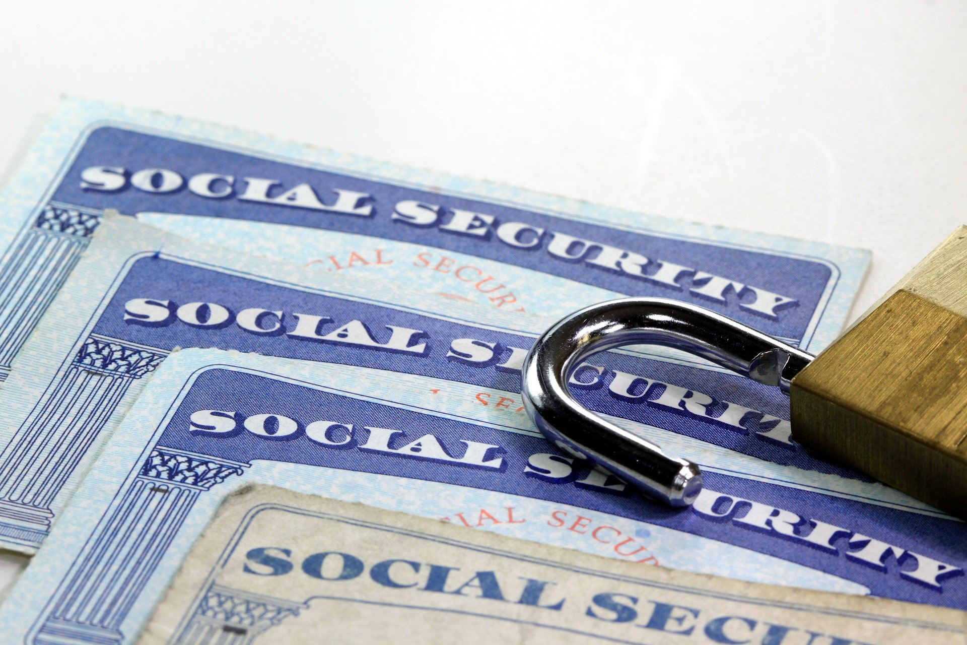 A padlock on Social Security cards