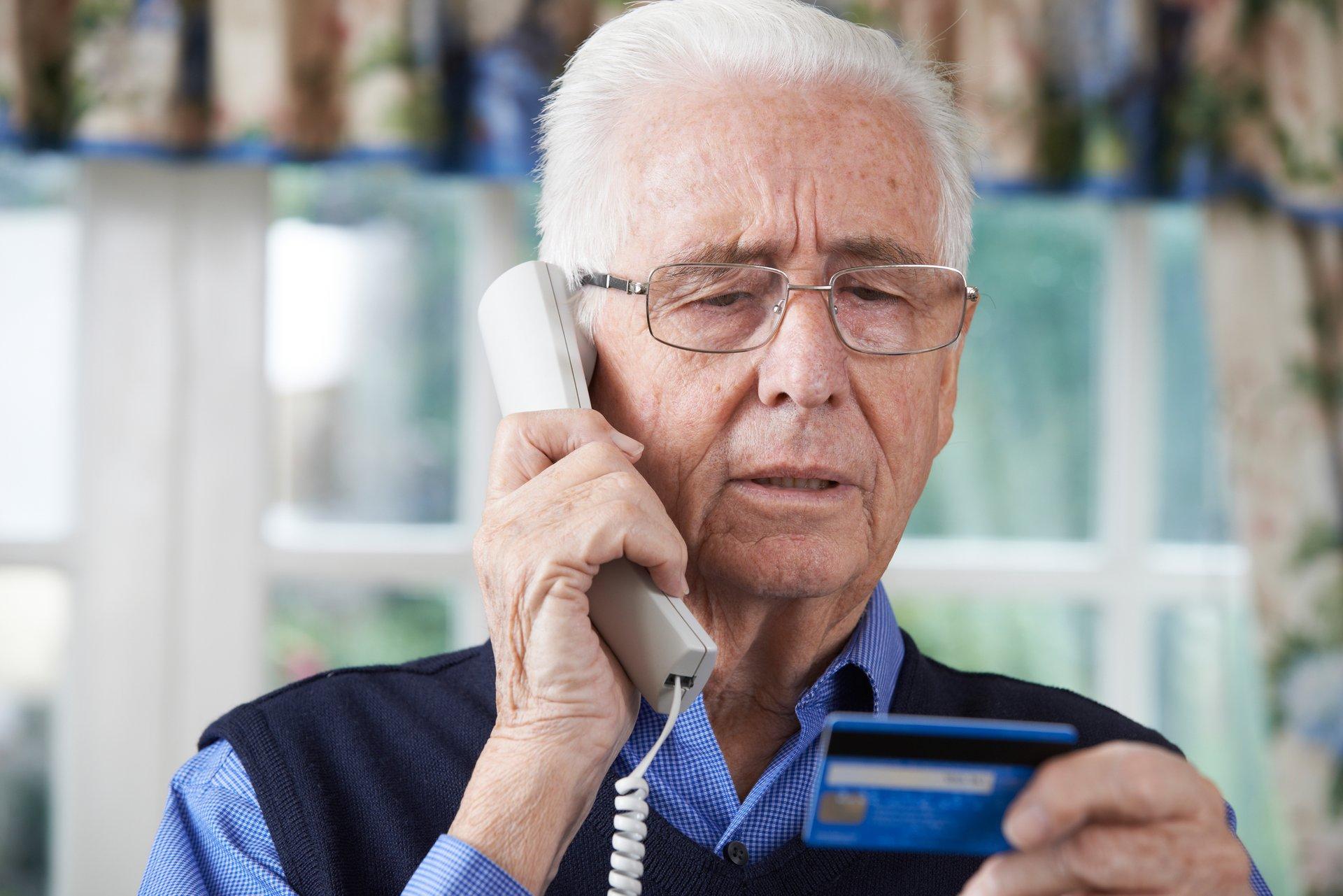 Senior Man Giving Credit Card