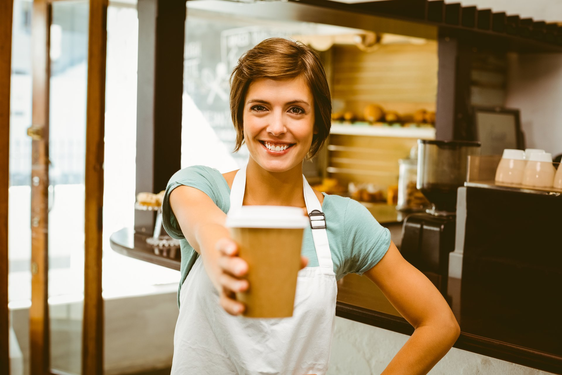 Barista holding coffee