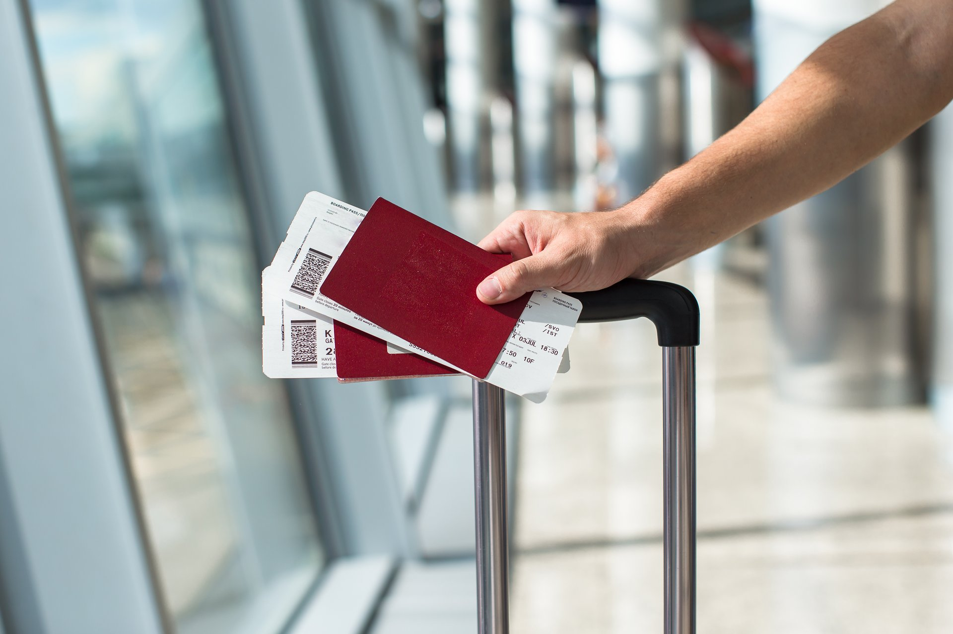 Traveler holding boarding passes and passports at the airport