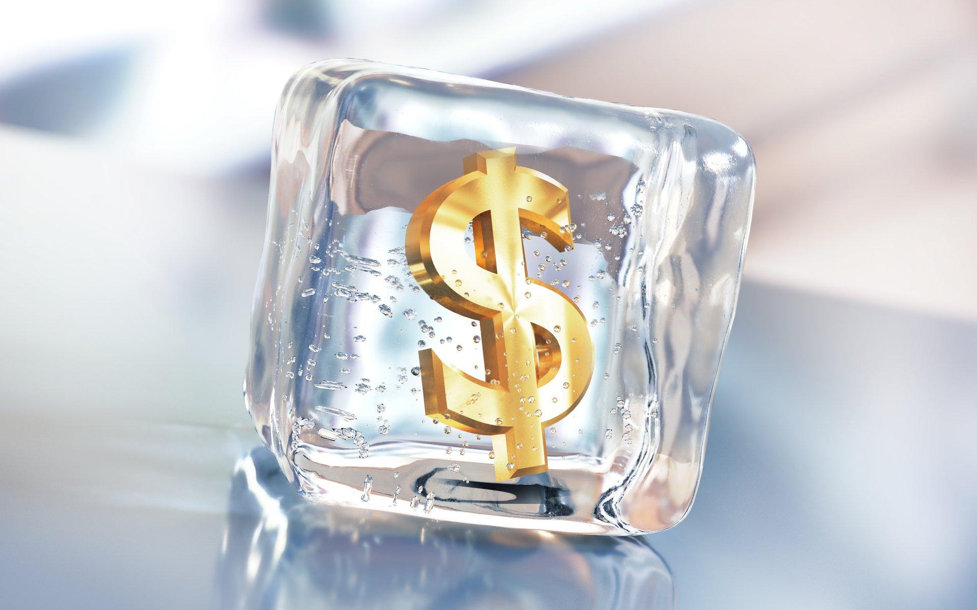 Dollar sign frozen in ice cube.