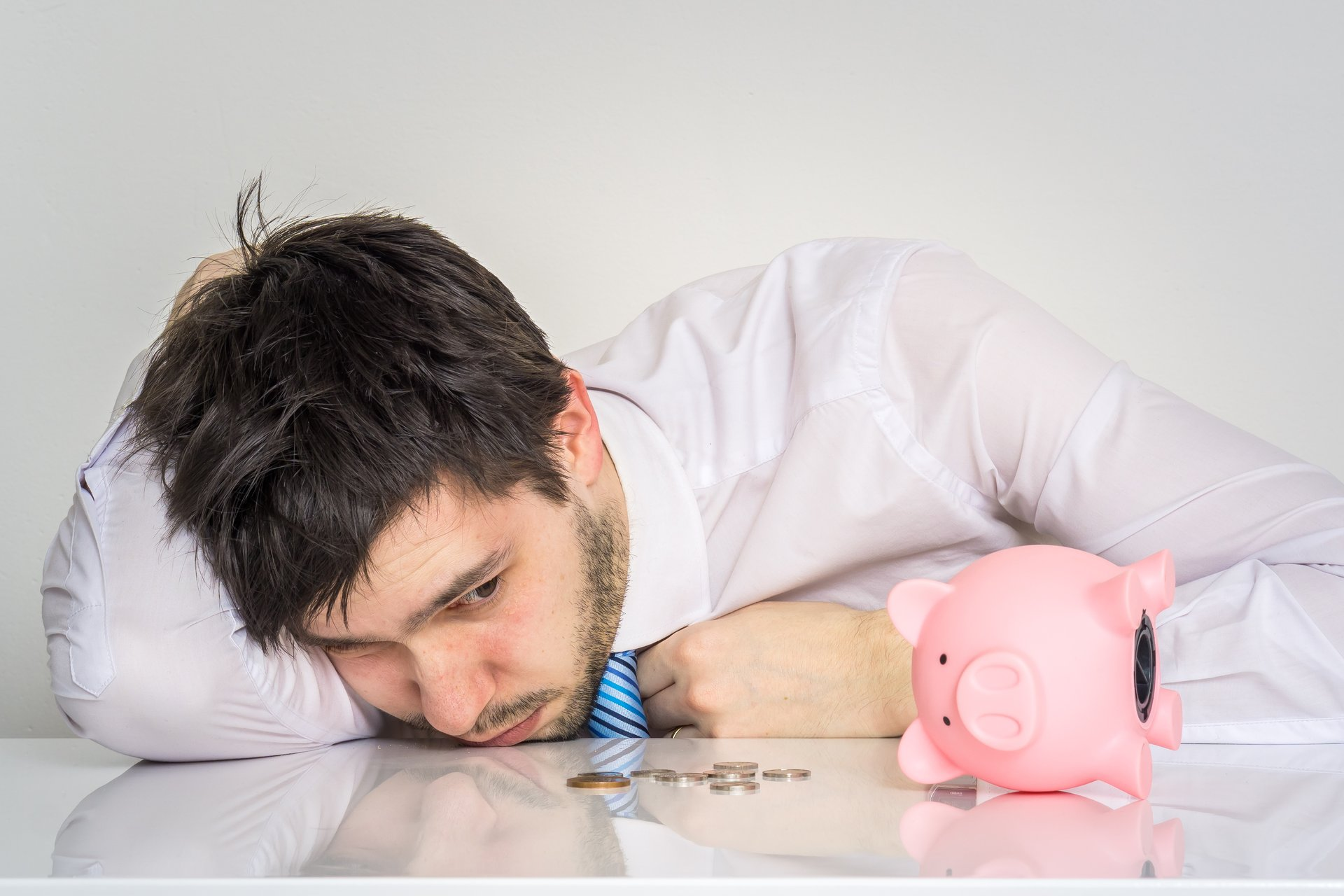Man with empty piggybank