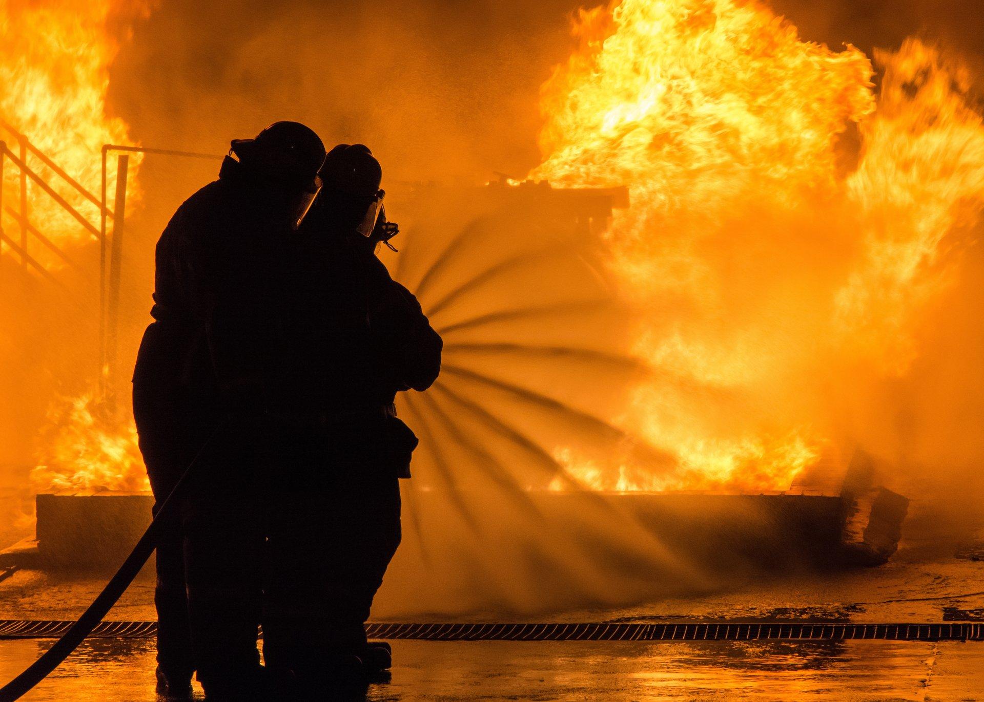 Firefighters extinguishing blaze