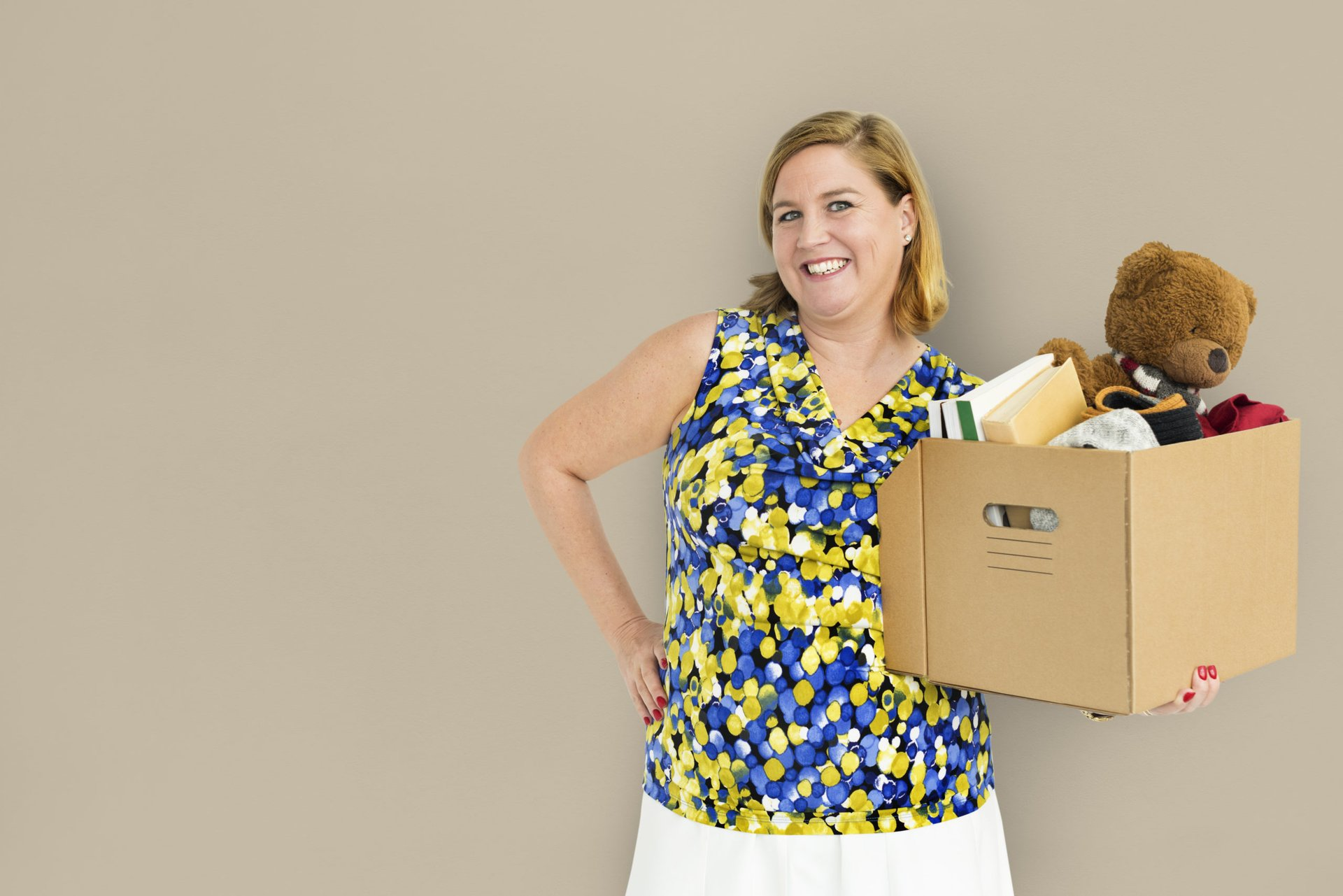 woman with box of clutter