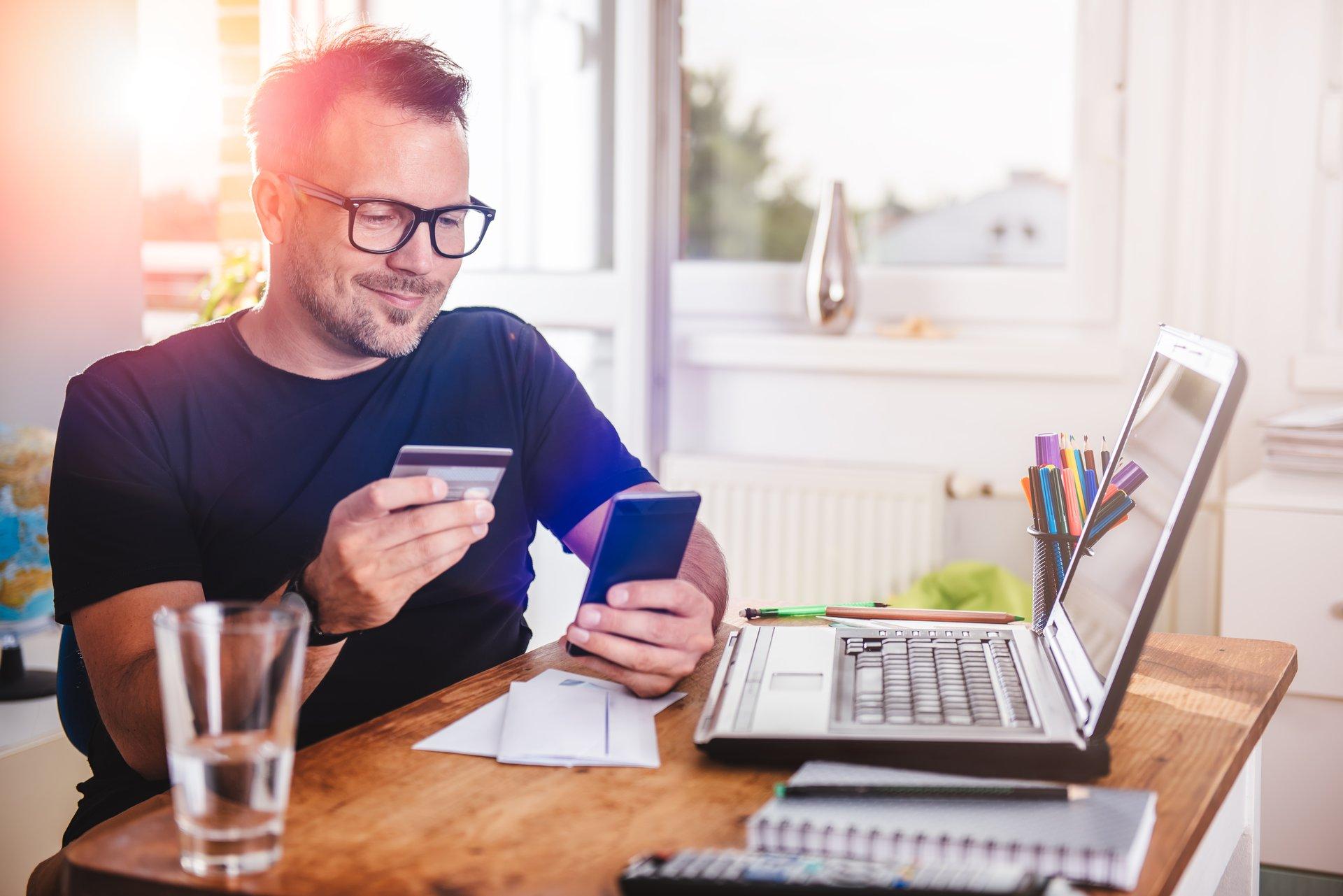 Man w Credit Card Computer