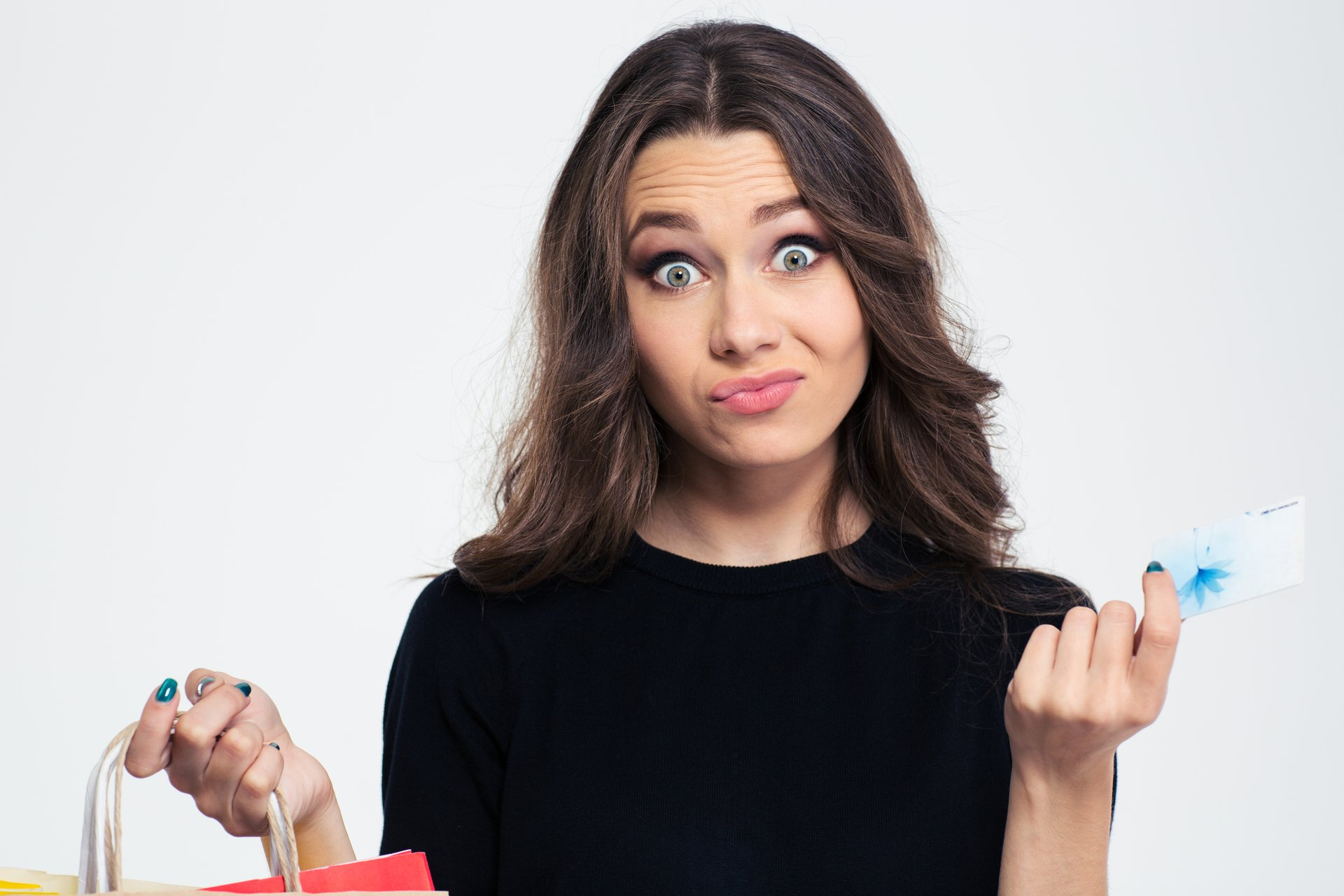 Unhappy woman with credit card