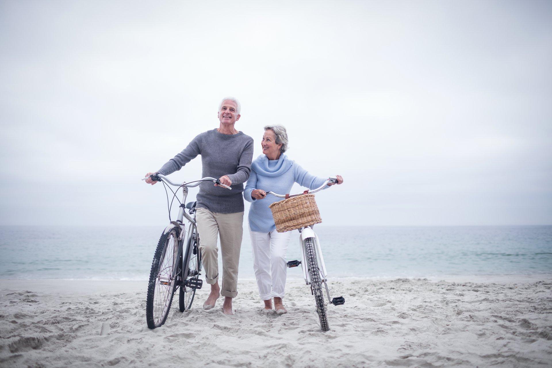 Senior Couple Beach Bikes