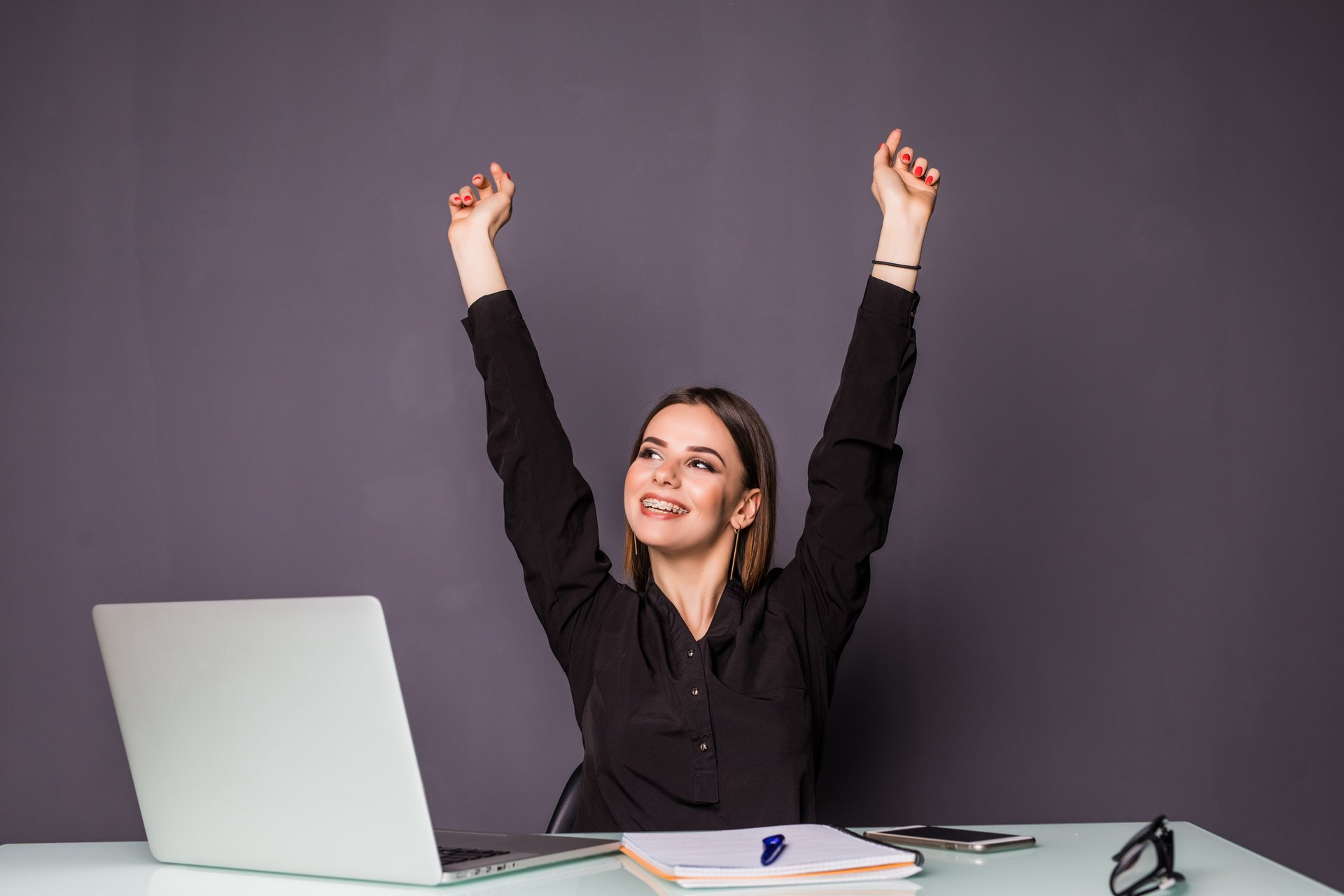 Woman happily working from home