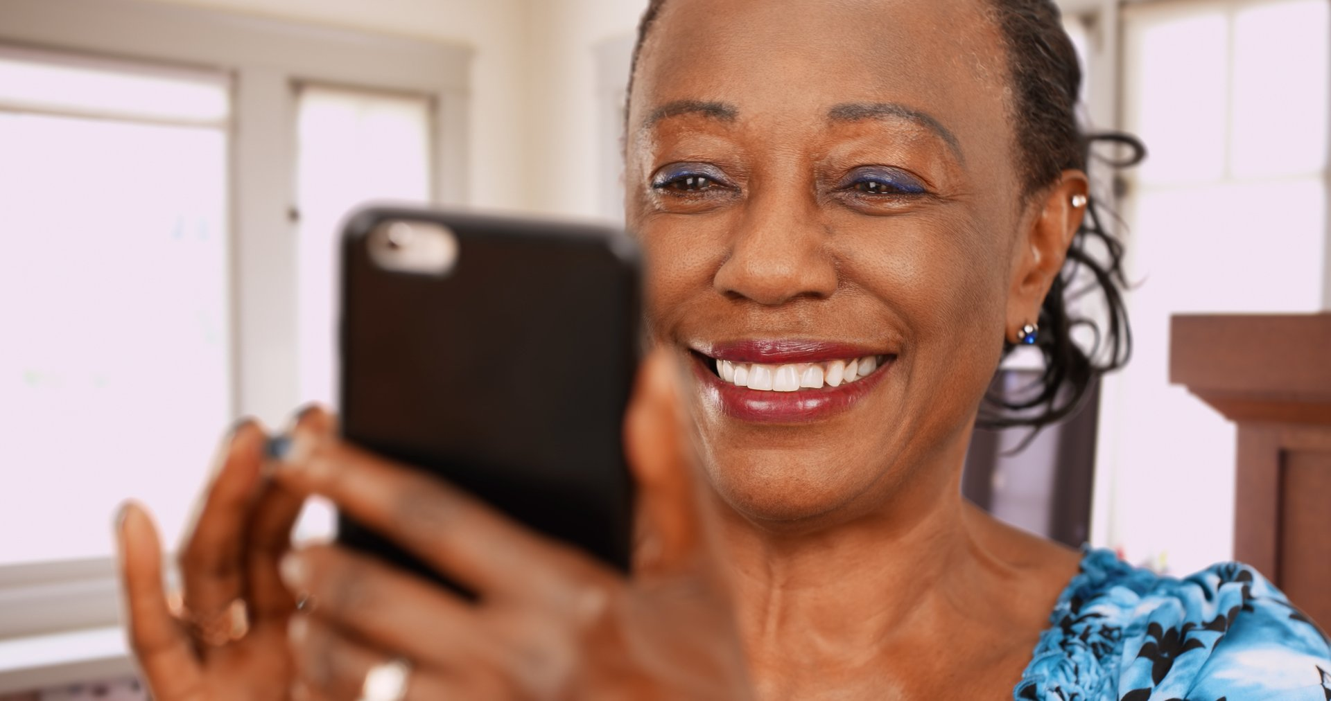 African American woman with cellphone
