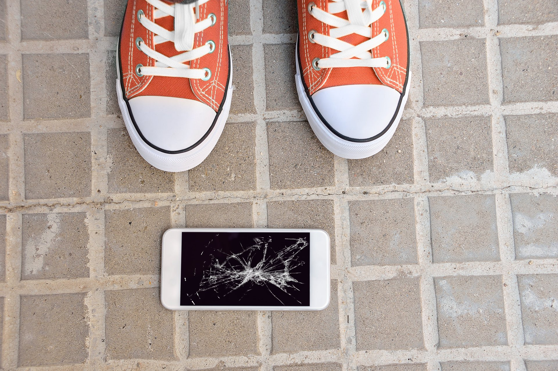 Shoes and broken cellphone