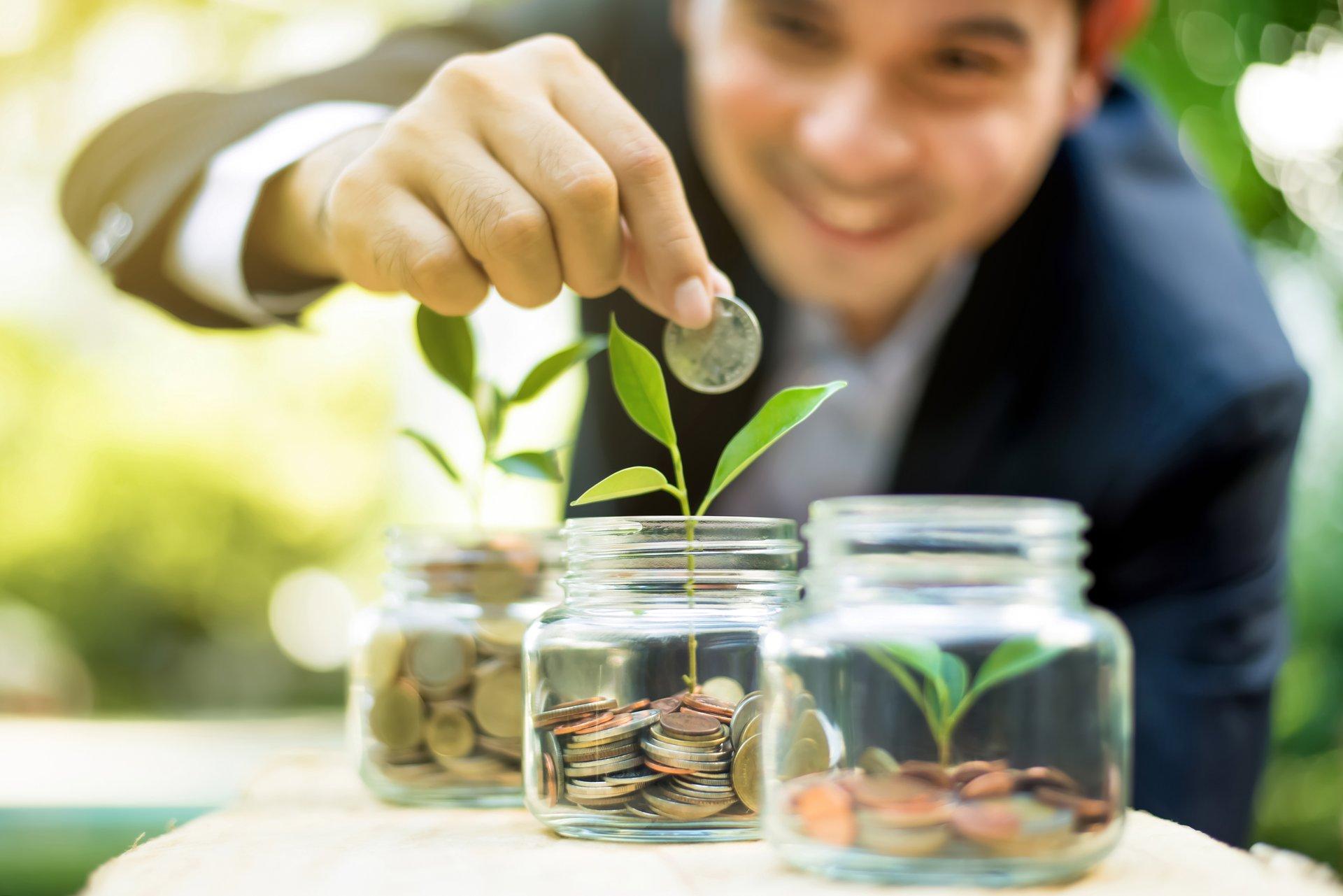 Putting money in jar
