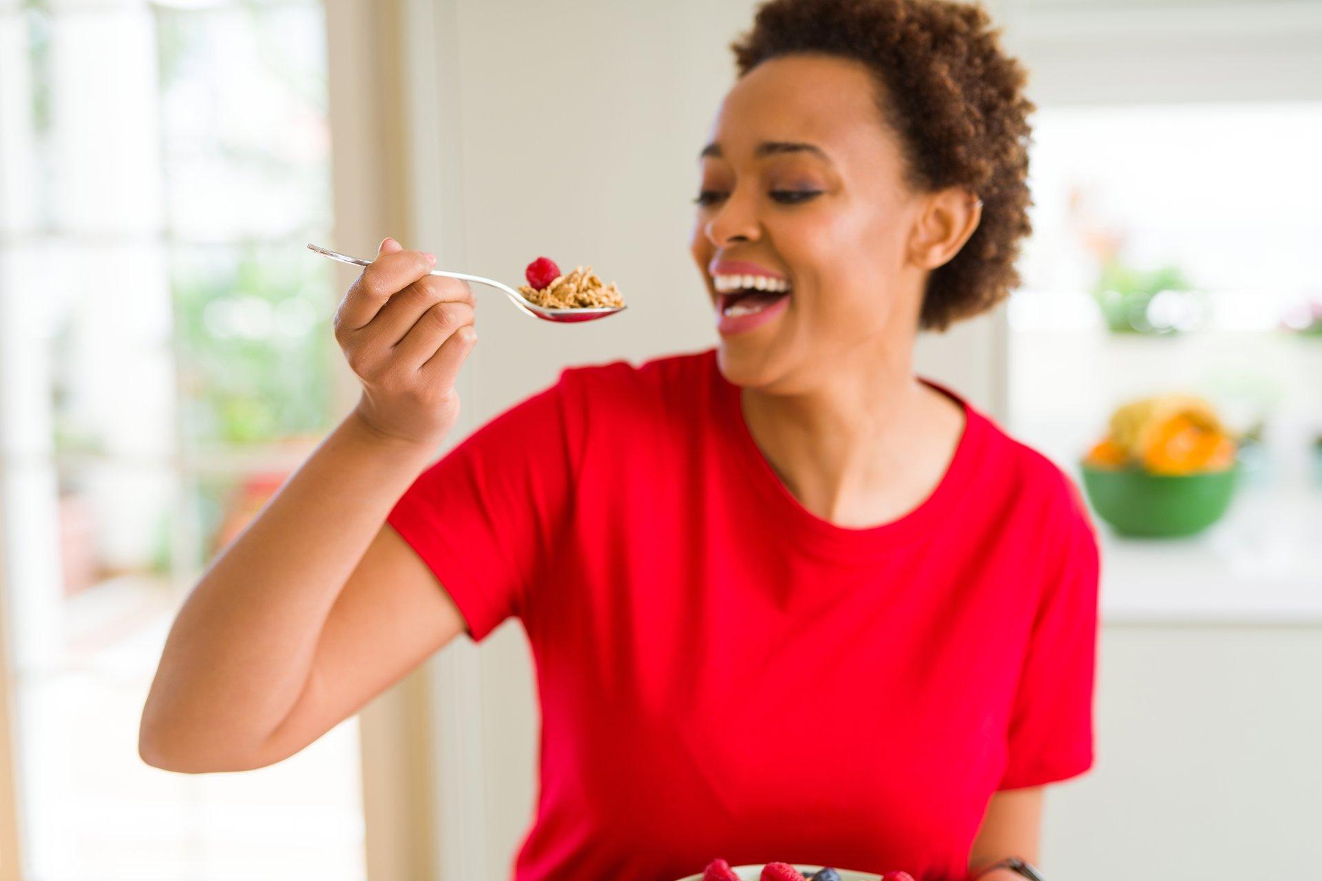 Woman eating healthful food