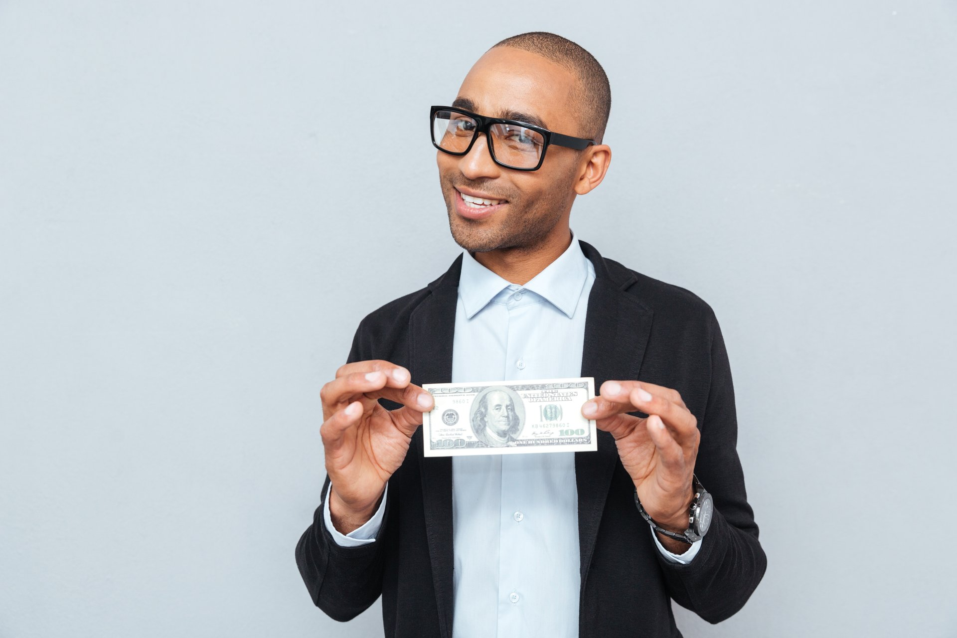 Happy man with dollar