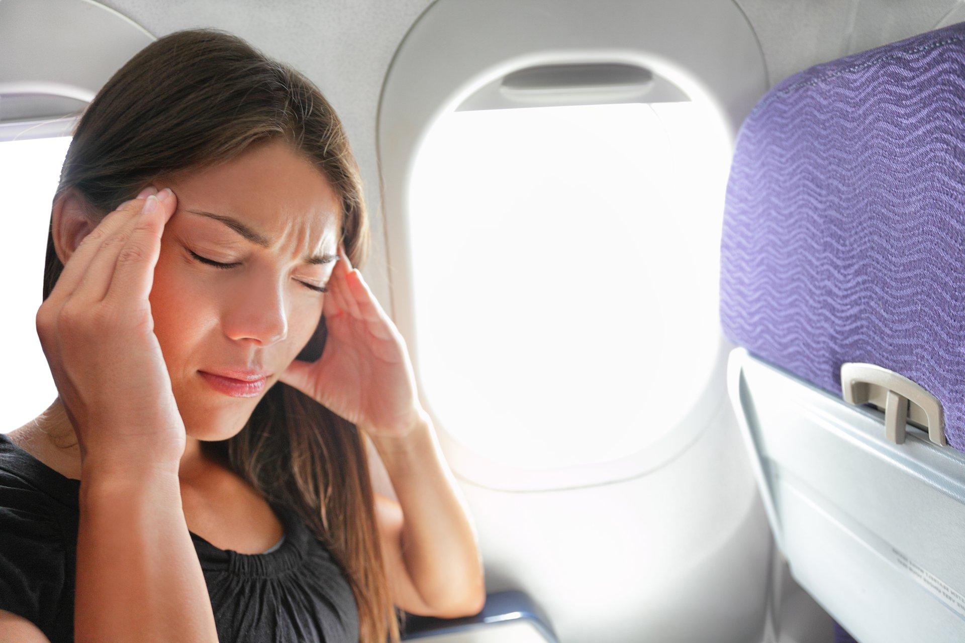 Unhappy woman on a plane