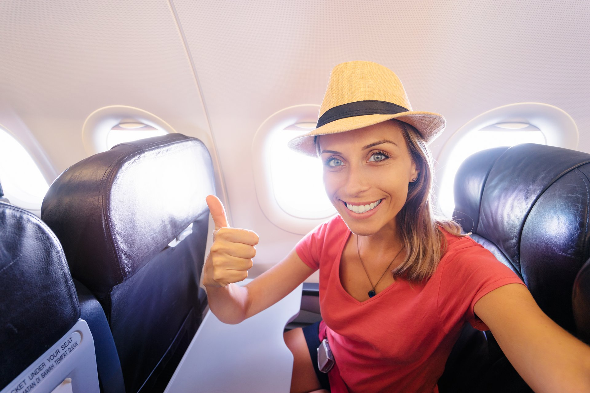Young woman in plane