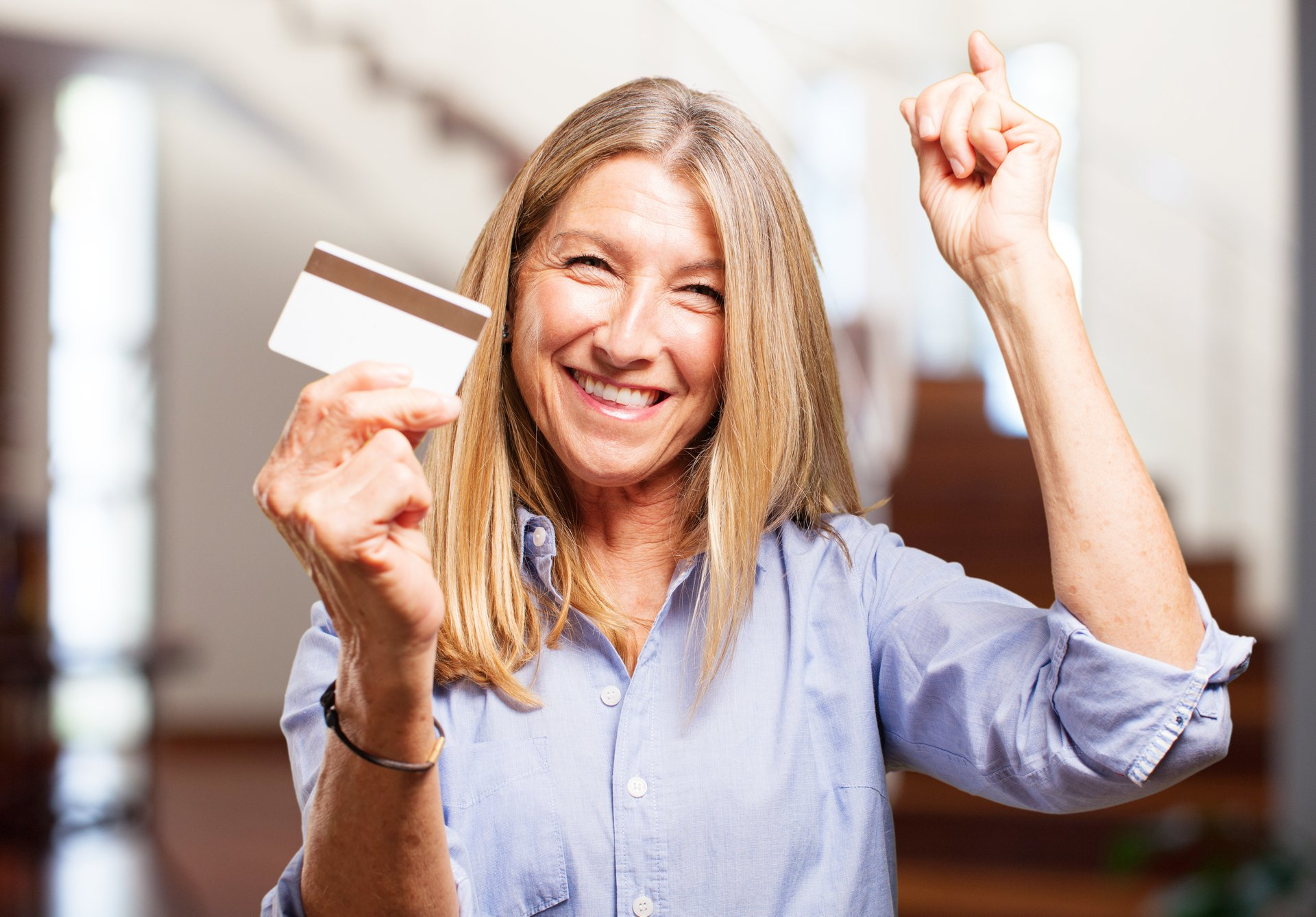 Happy woman with card