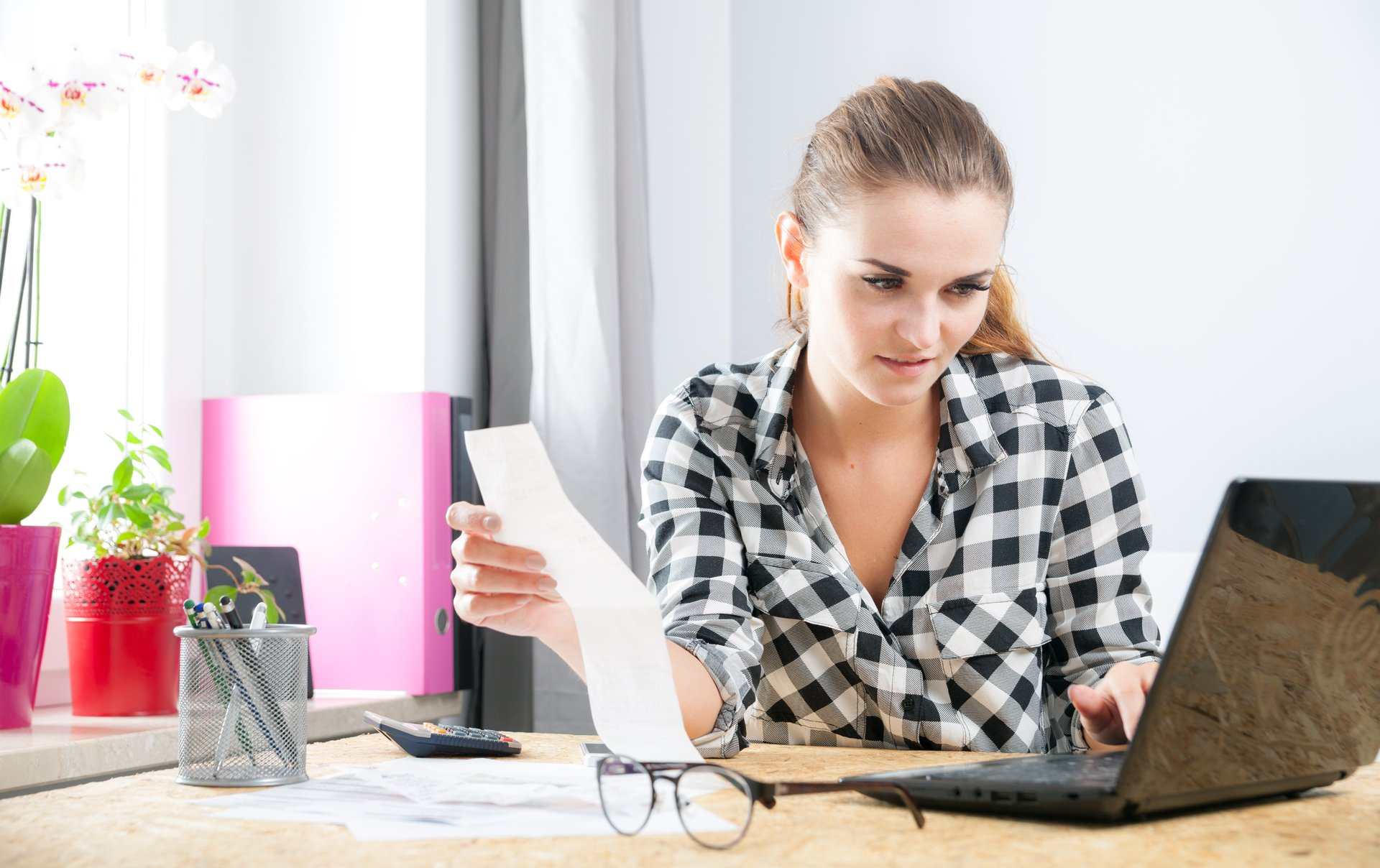 Woman looking at her debts