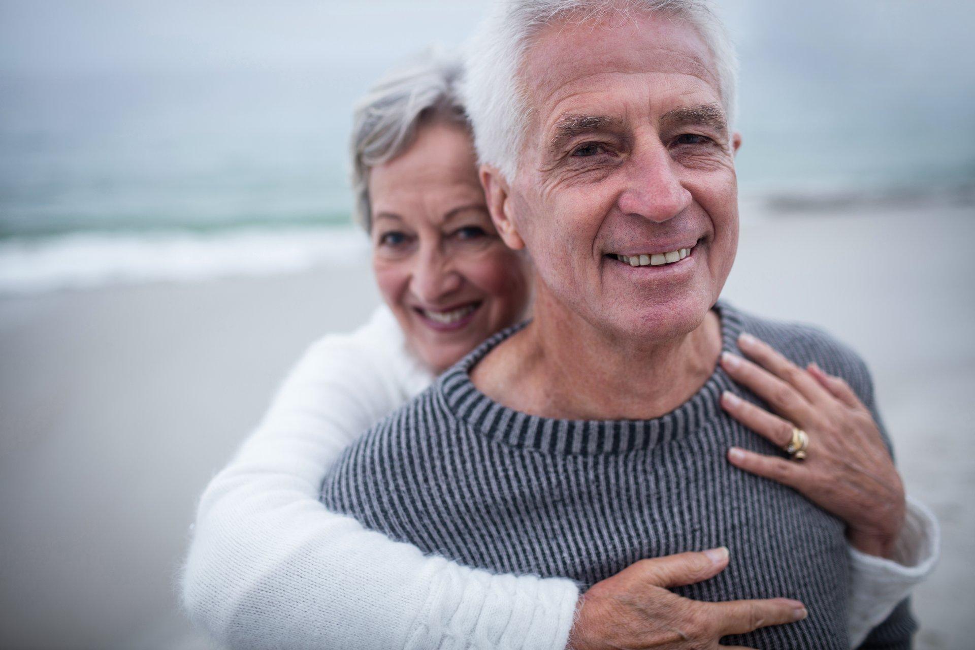 Handsome senior couple on the beach