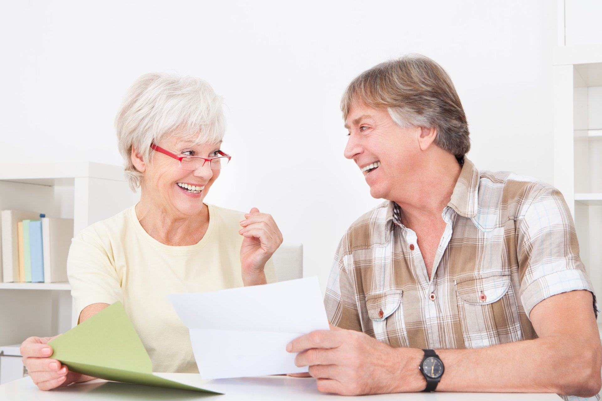 retired couple reviewing tax documents