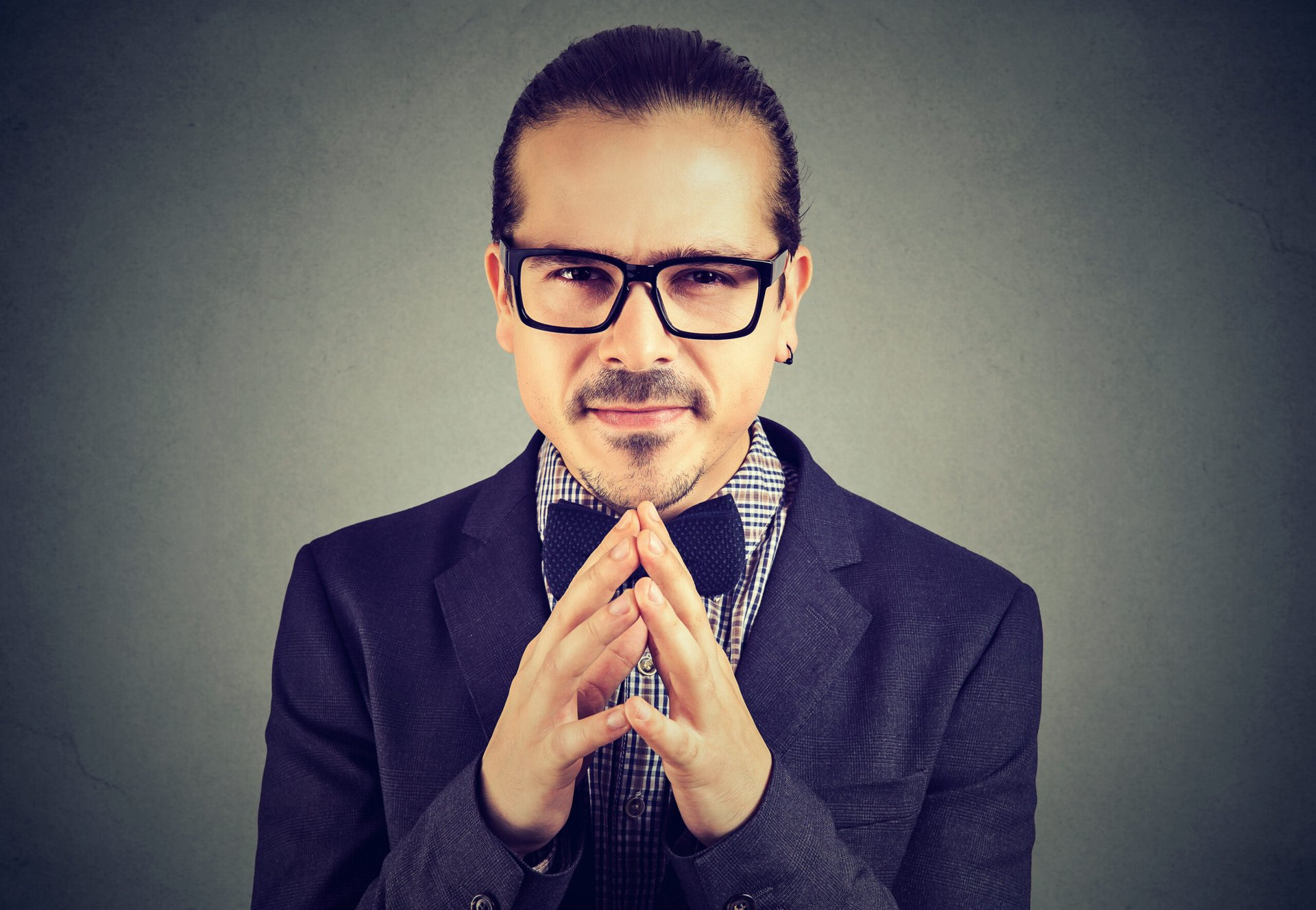 Sly businessman in glasses