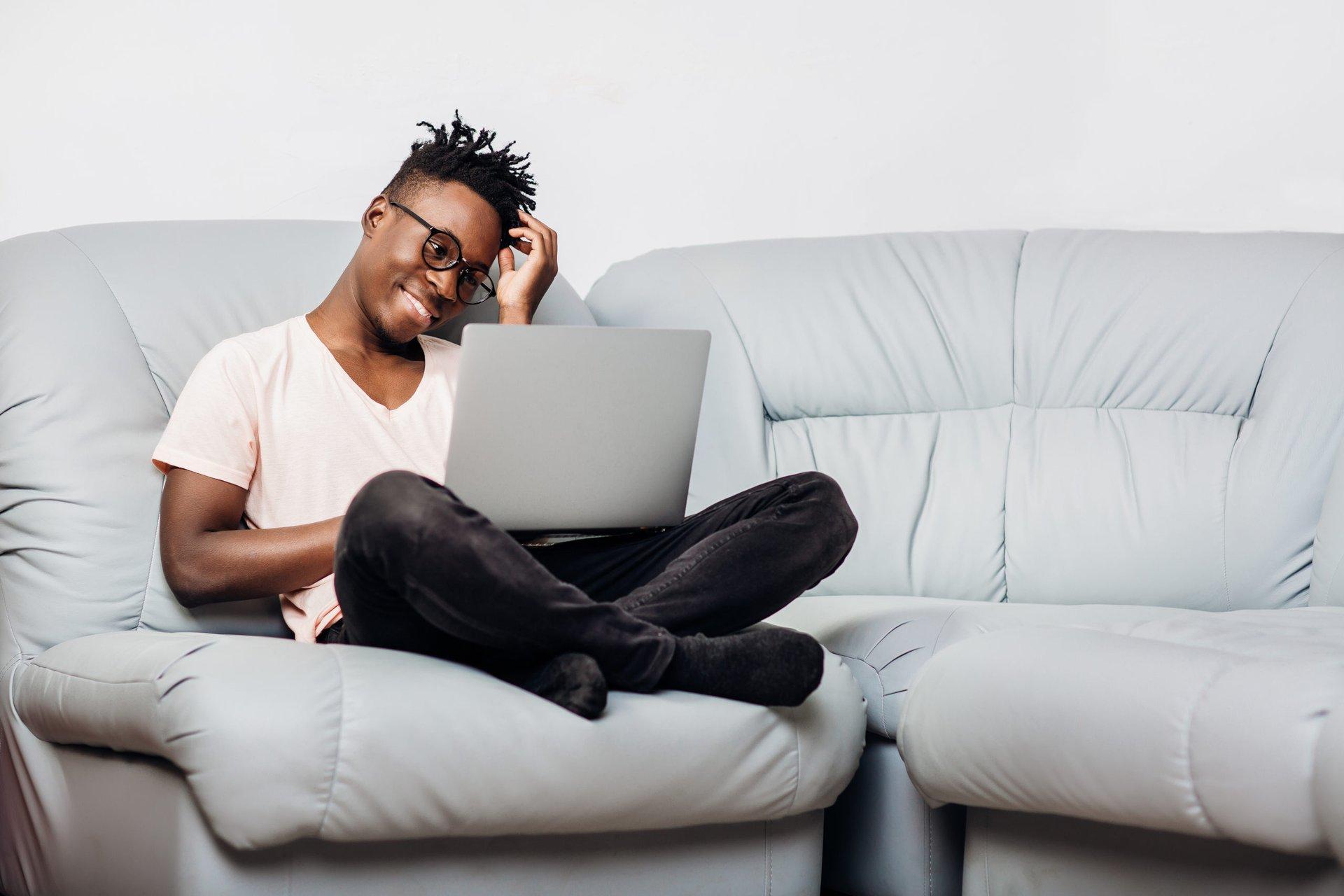 Man using free antivirus software on a laptop