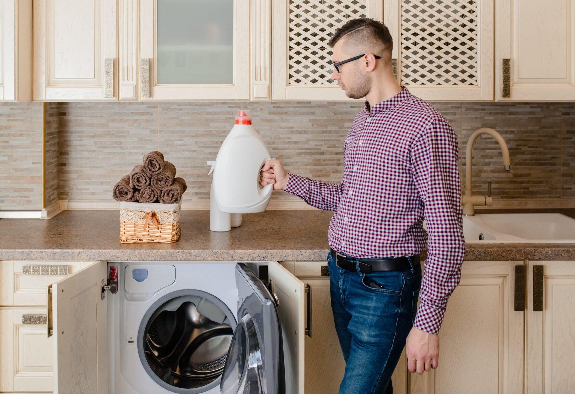 Man holding laundry detergent