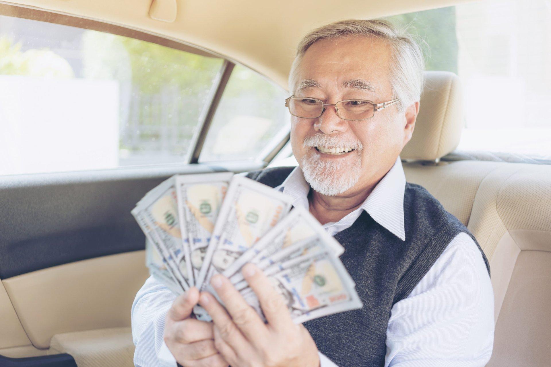 Senior man with dollars