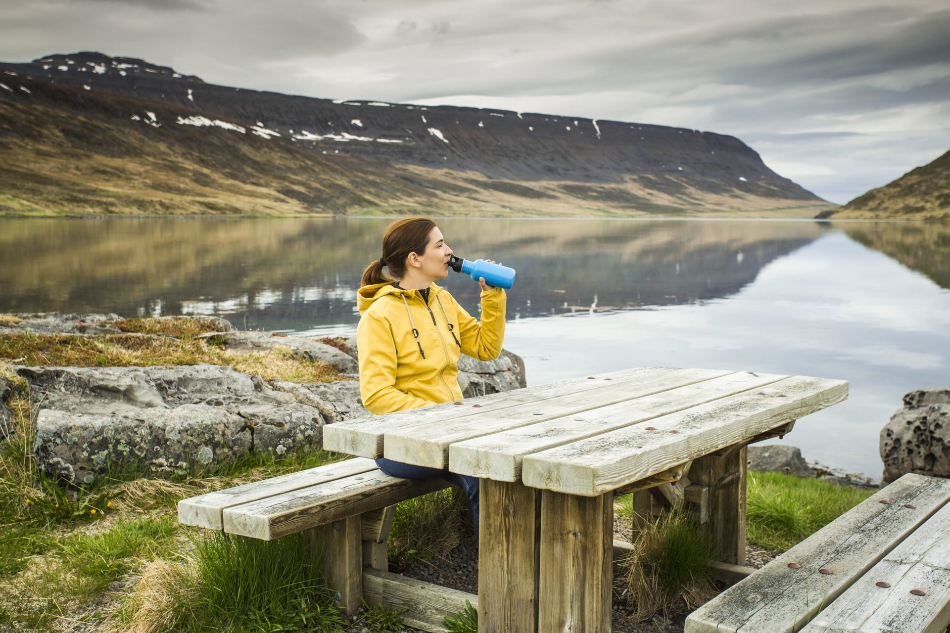 Woman drinking from a reusable water bottle