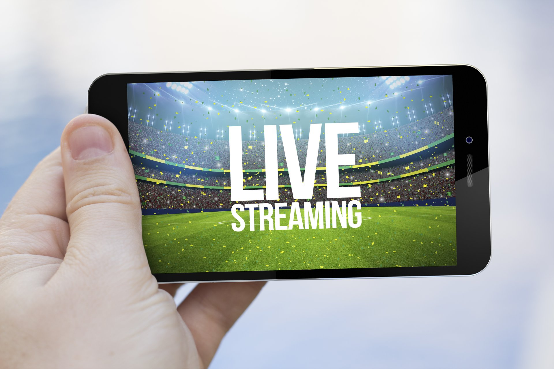 """Hand holding cellphone with """"Live Streaming"""" on screen."""