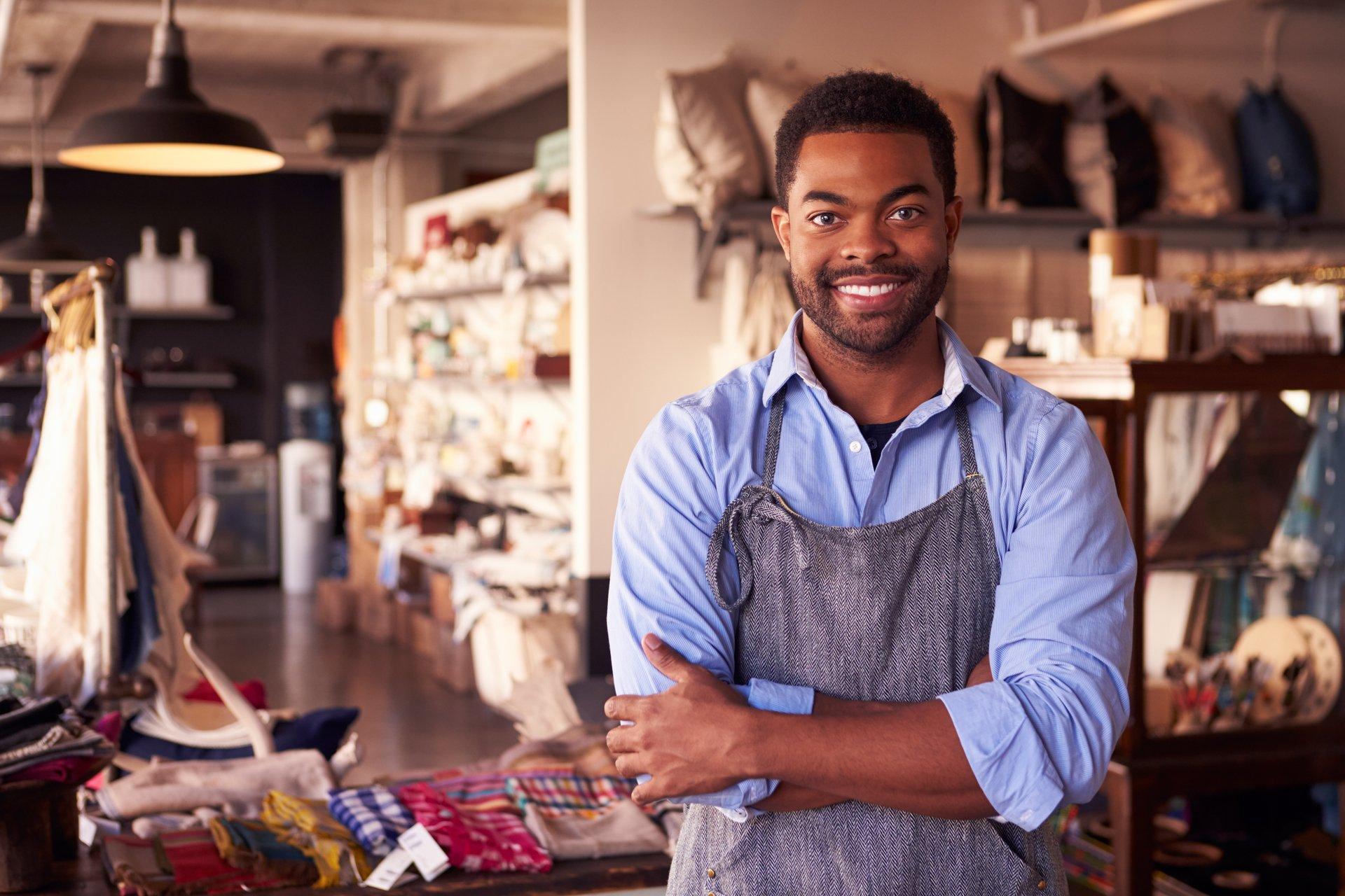 Gift shop owner, smiling