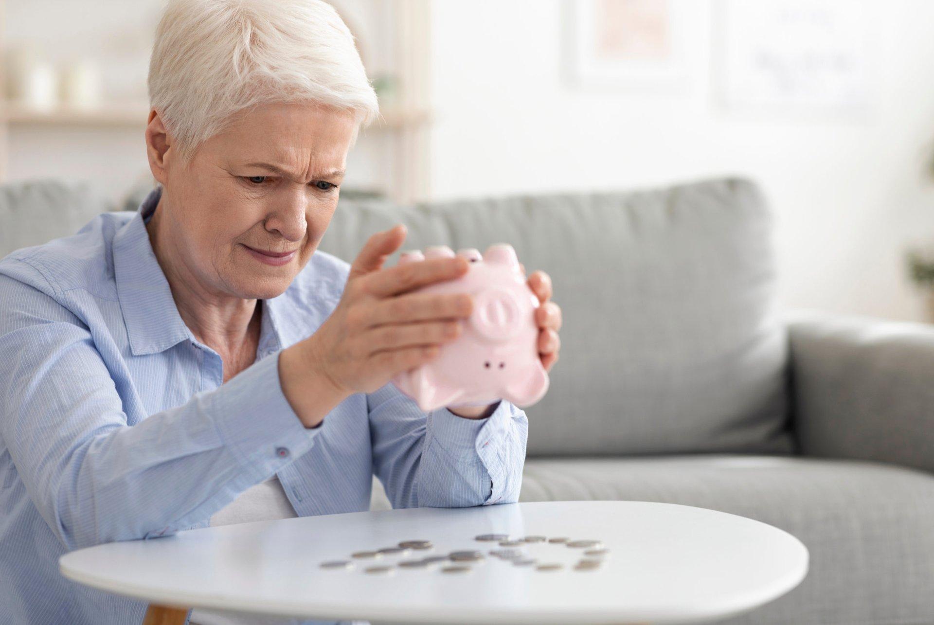 senior empties a piggy bank