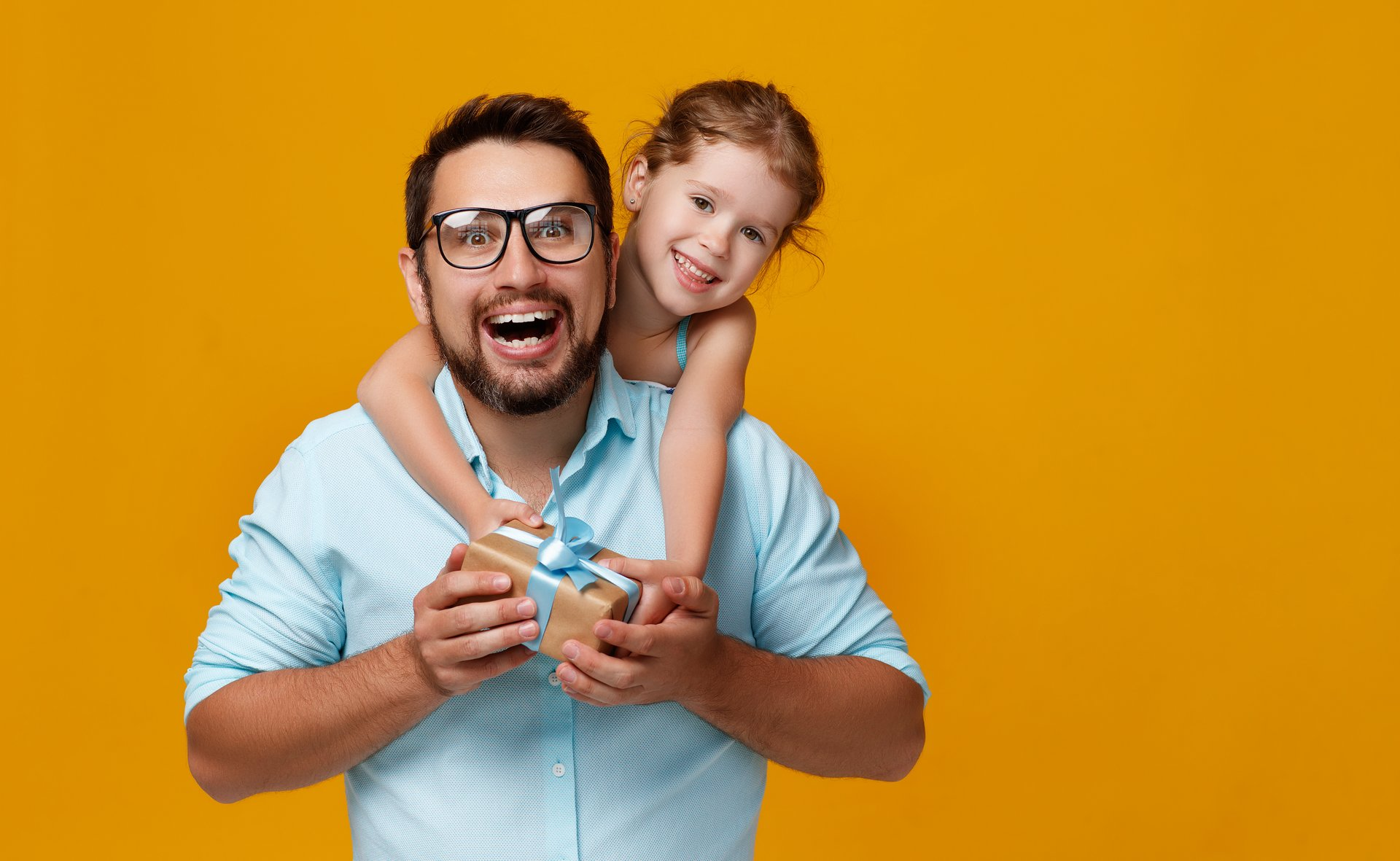 Father and daughter with gift