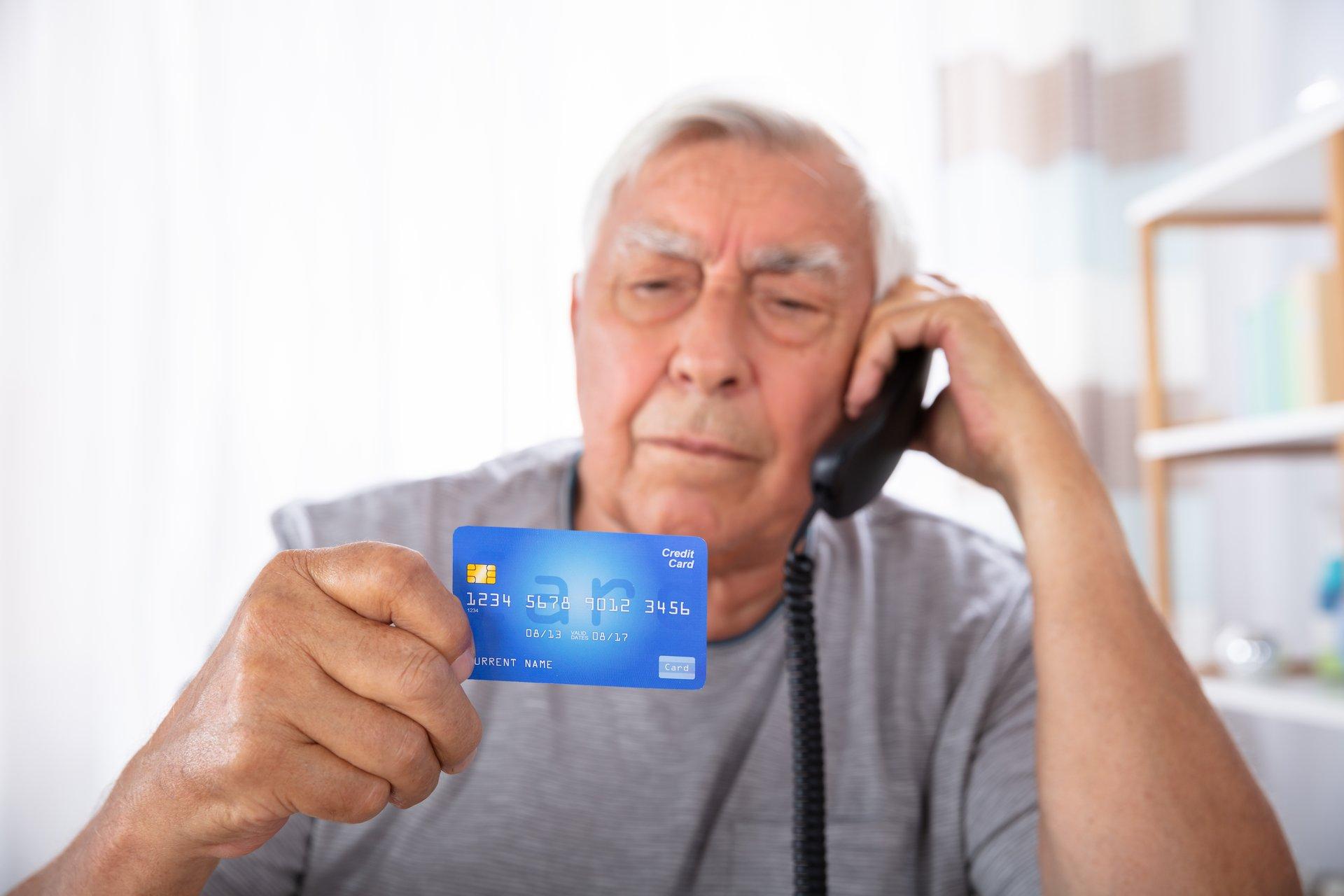 Elder Senior Man Credit Card Landline Phone
