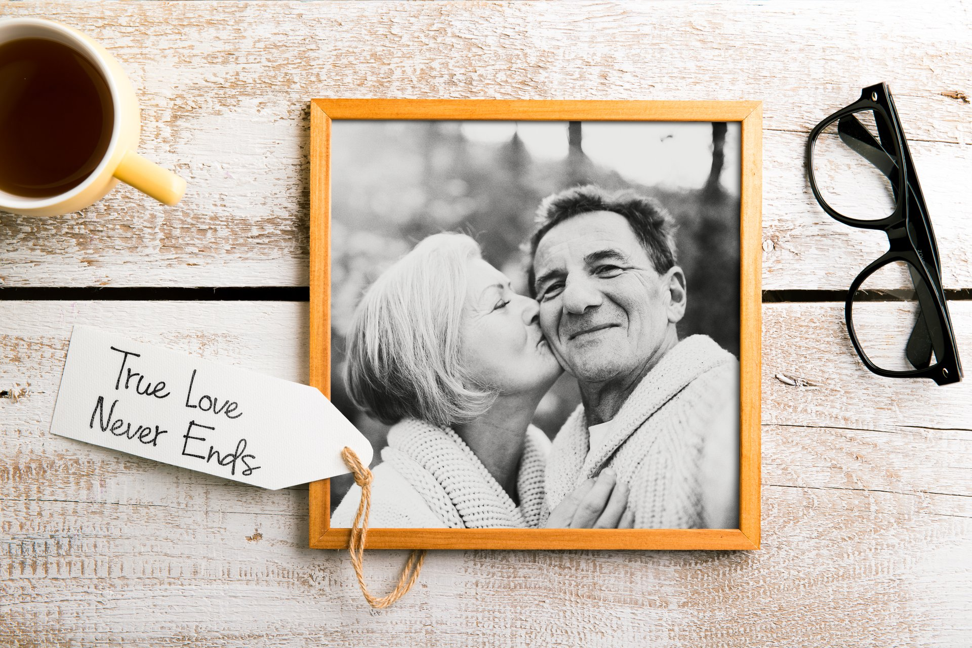 Black-and-white photo of seniors in picture frame