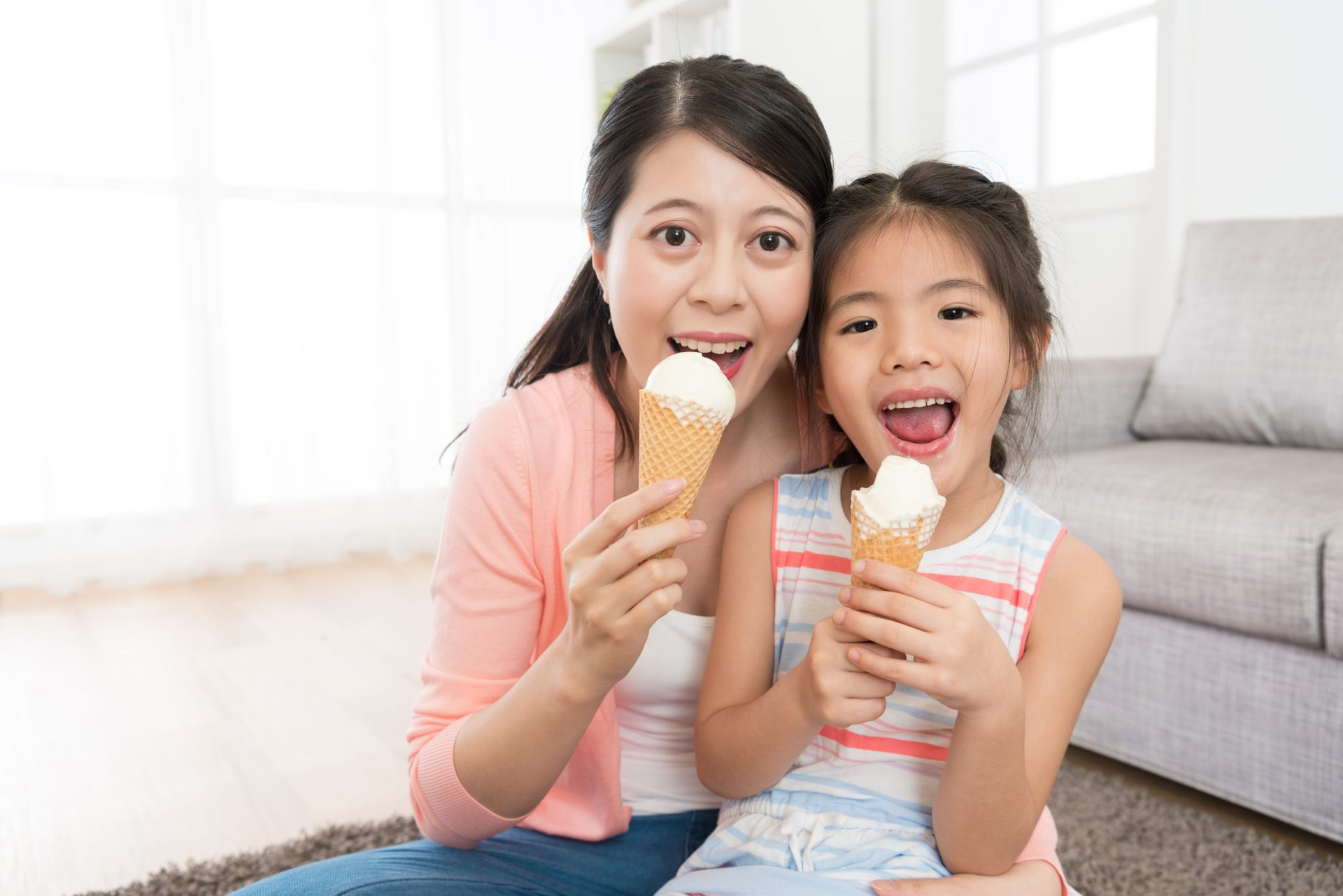 A mother and daughter eat homemade ice cream