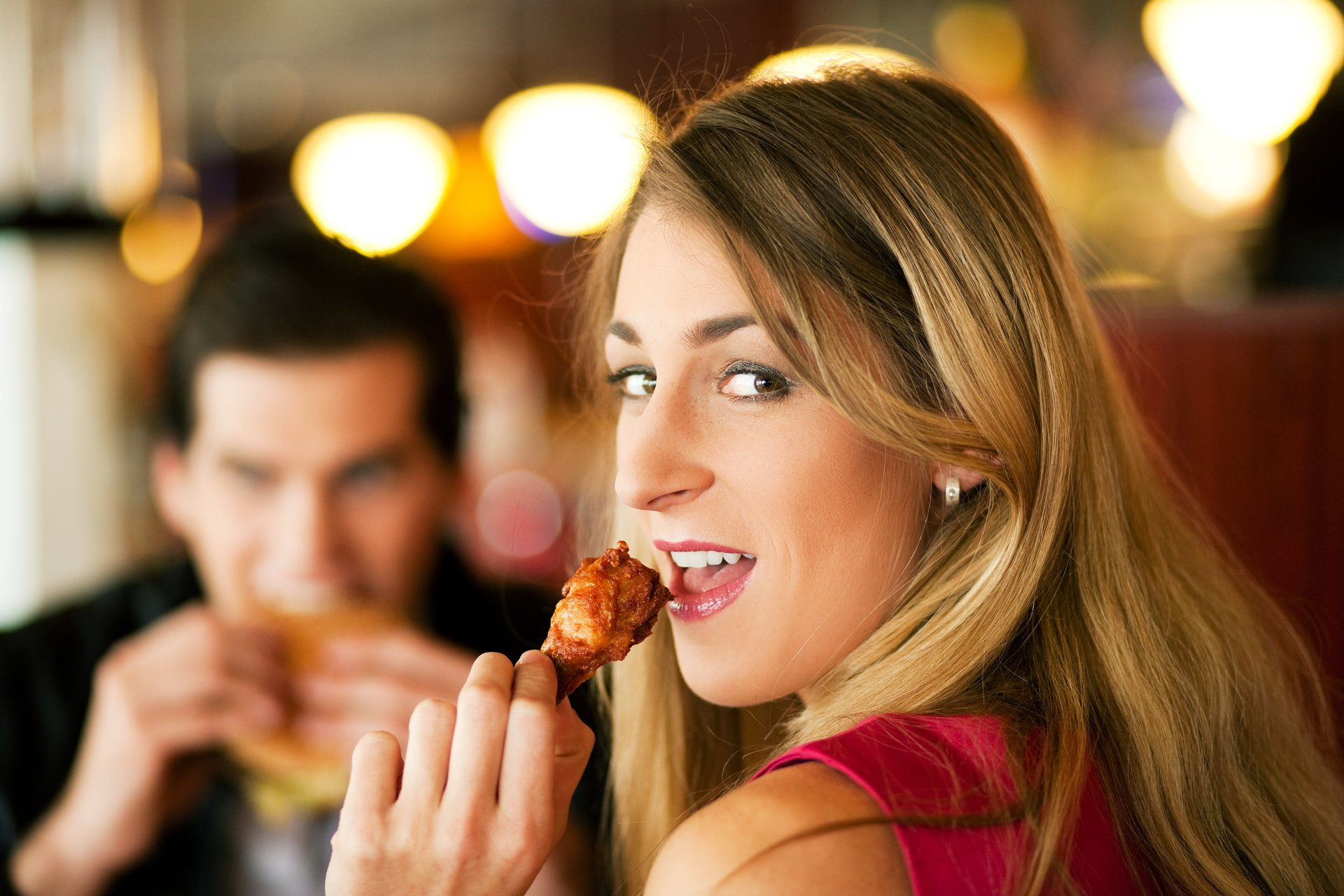 Woman eating chicken wings